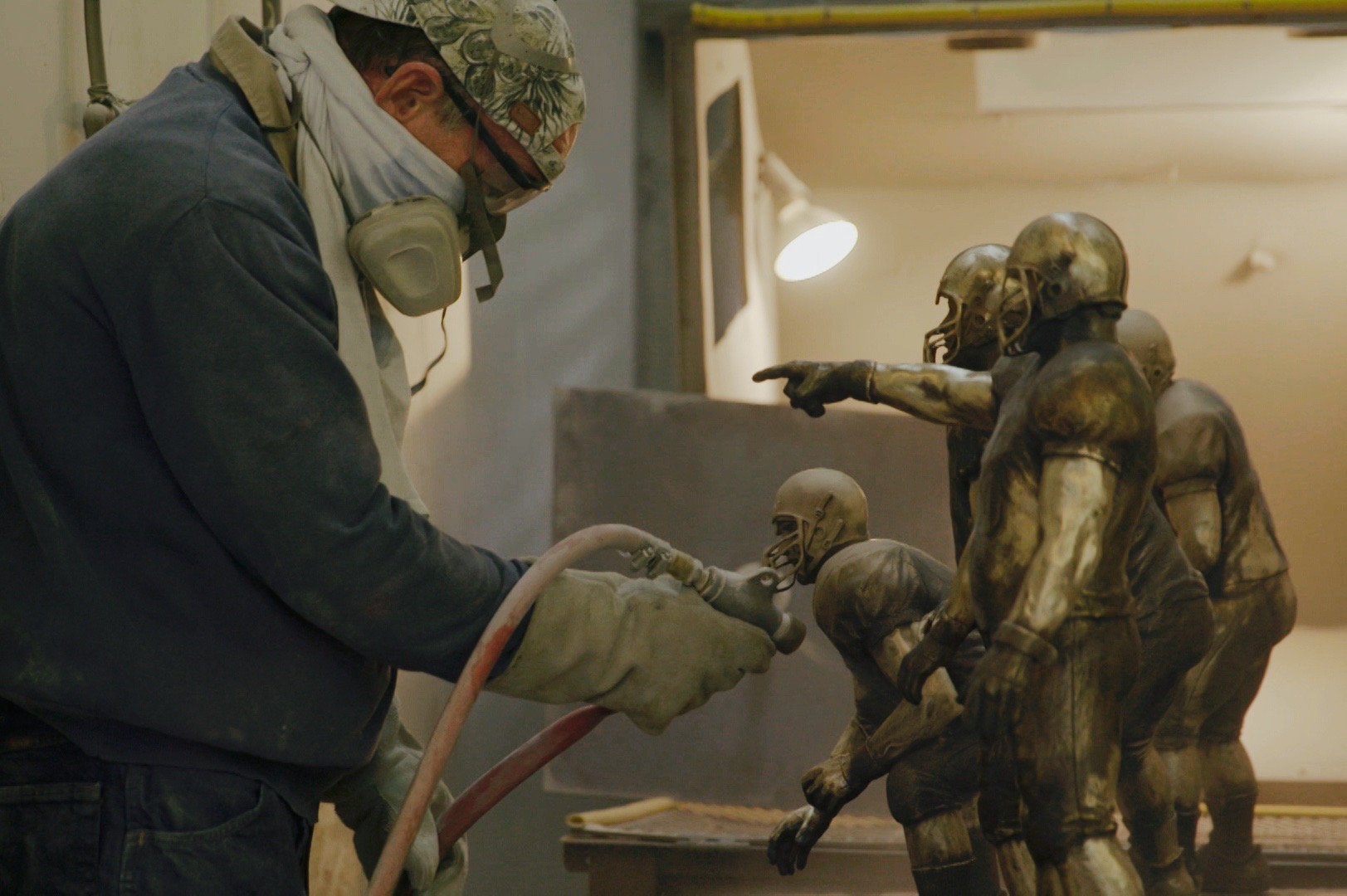 The Joe Moore Award trophy, built by a team led by legendary sports sculptor Jerry McKenna, is sandblasted in preparation for its unveiling