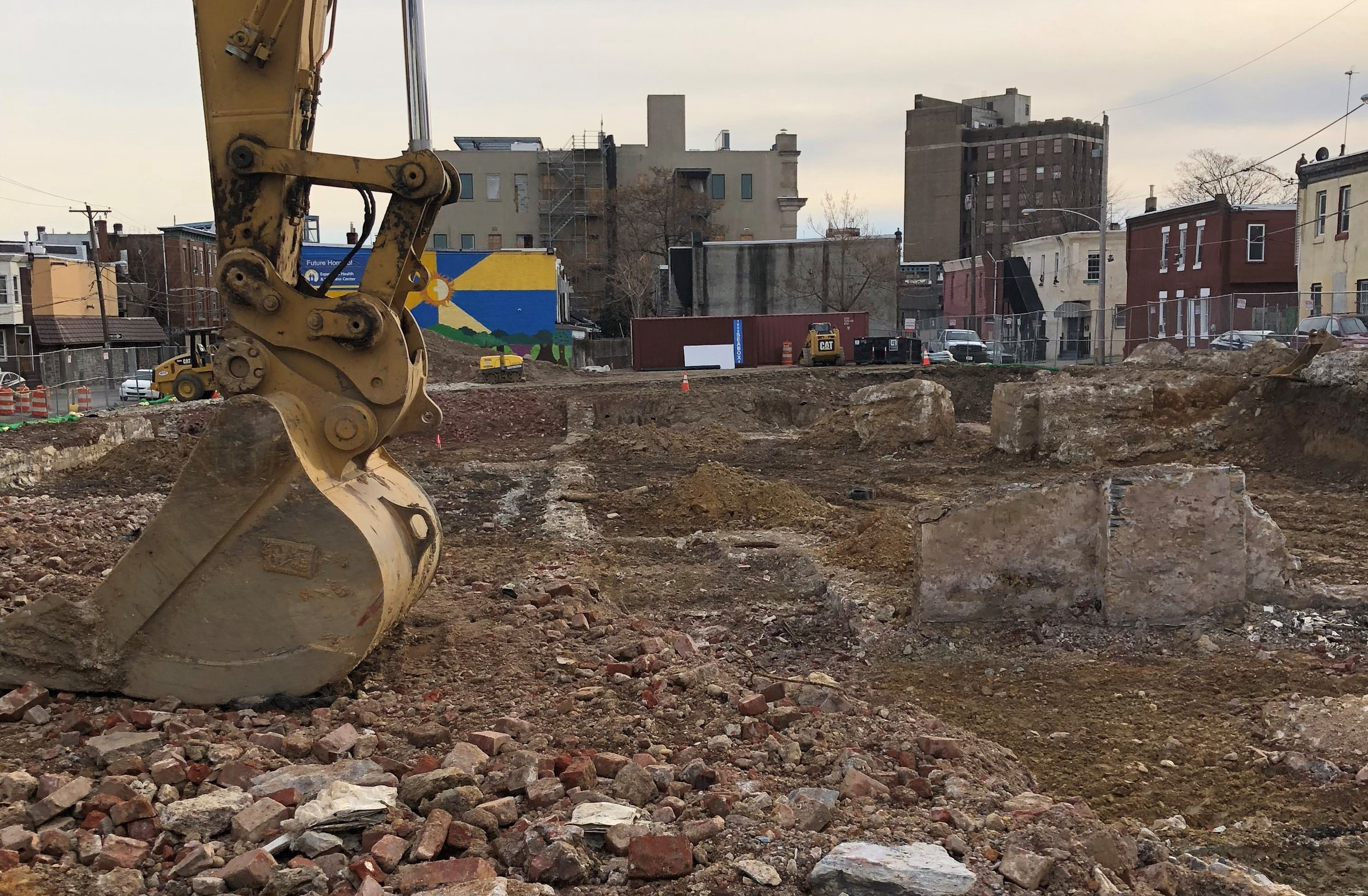 An excavator lies still at the site of Esperanza Health Center's forthcoming parking structure.