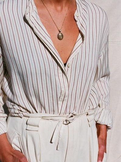 For a date with a guy you want to be friends with    Vintage Thin Striped Button Up Blouse from NANIN $42