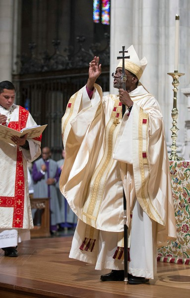 Newly consecrated Presiding Bishop and Anglican Primate, the Most Reverend Michael B. Curry, gives the episcopal blessing at the conclusion of the Institution Eucharist at National Cathedral in Washington, D.C.