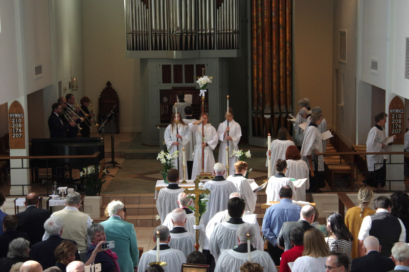 The entrance procession on Easter Sunday morning with choir, acolytes, brass quartet and organ leading congregational singing.
