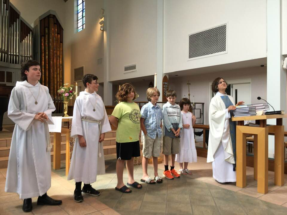 Some of the many Holy Trinity children and youth who received their own Bibles from the parish on the Sixth Sunday after Easter this year.