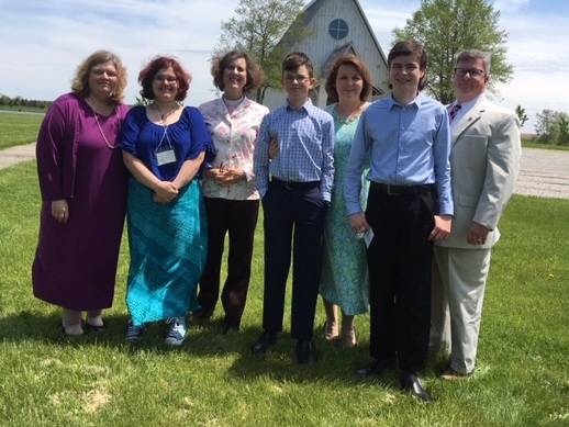 Torie Dobson with her mother Jeanine, Rev. Sara Palmer, and the Harper family: Thomas, Suzanne, Henry, and John after their Confirmation at the Procter Center in May 2019