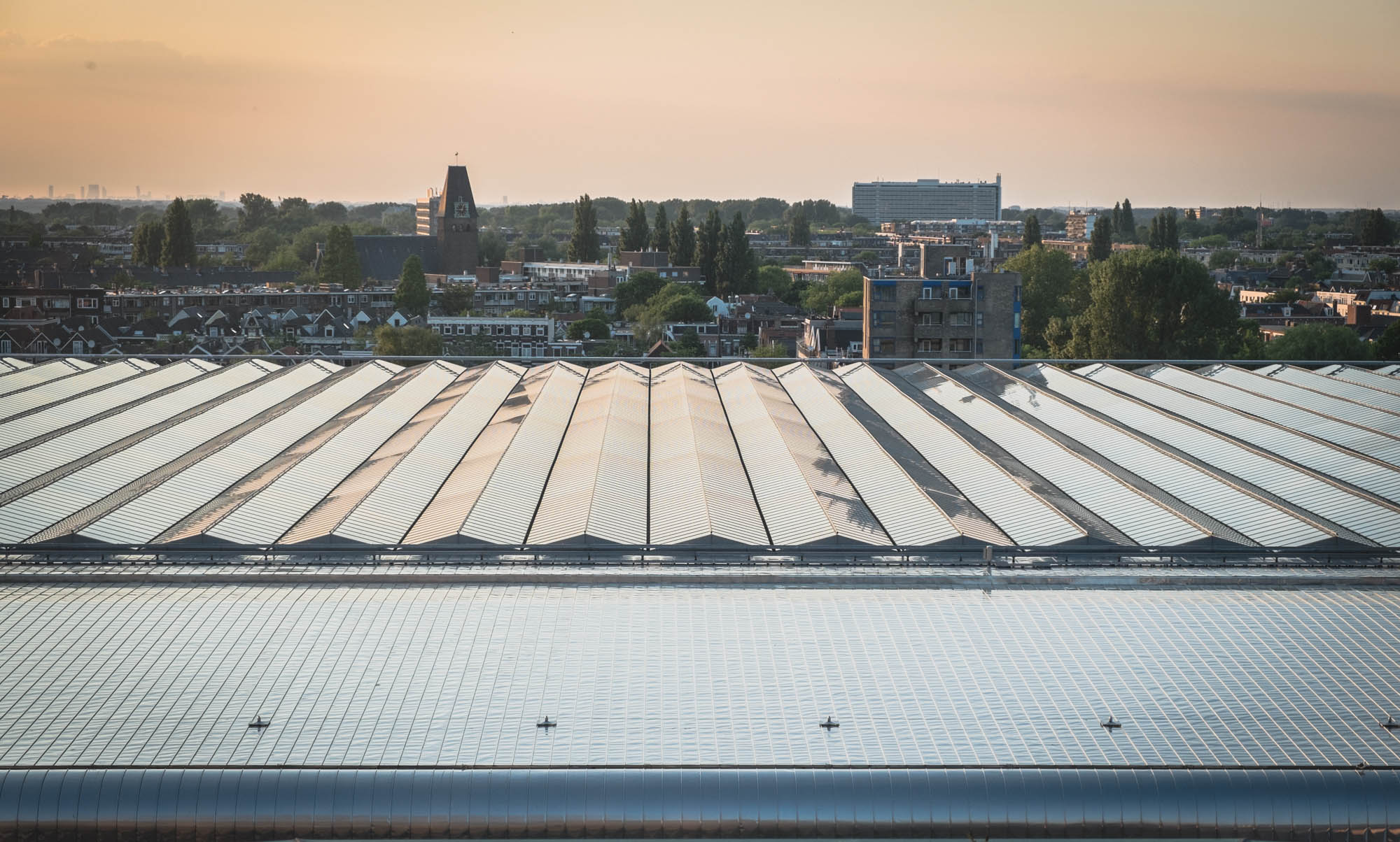 Rooftop of Amsterdam Central seen as a fertile ground