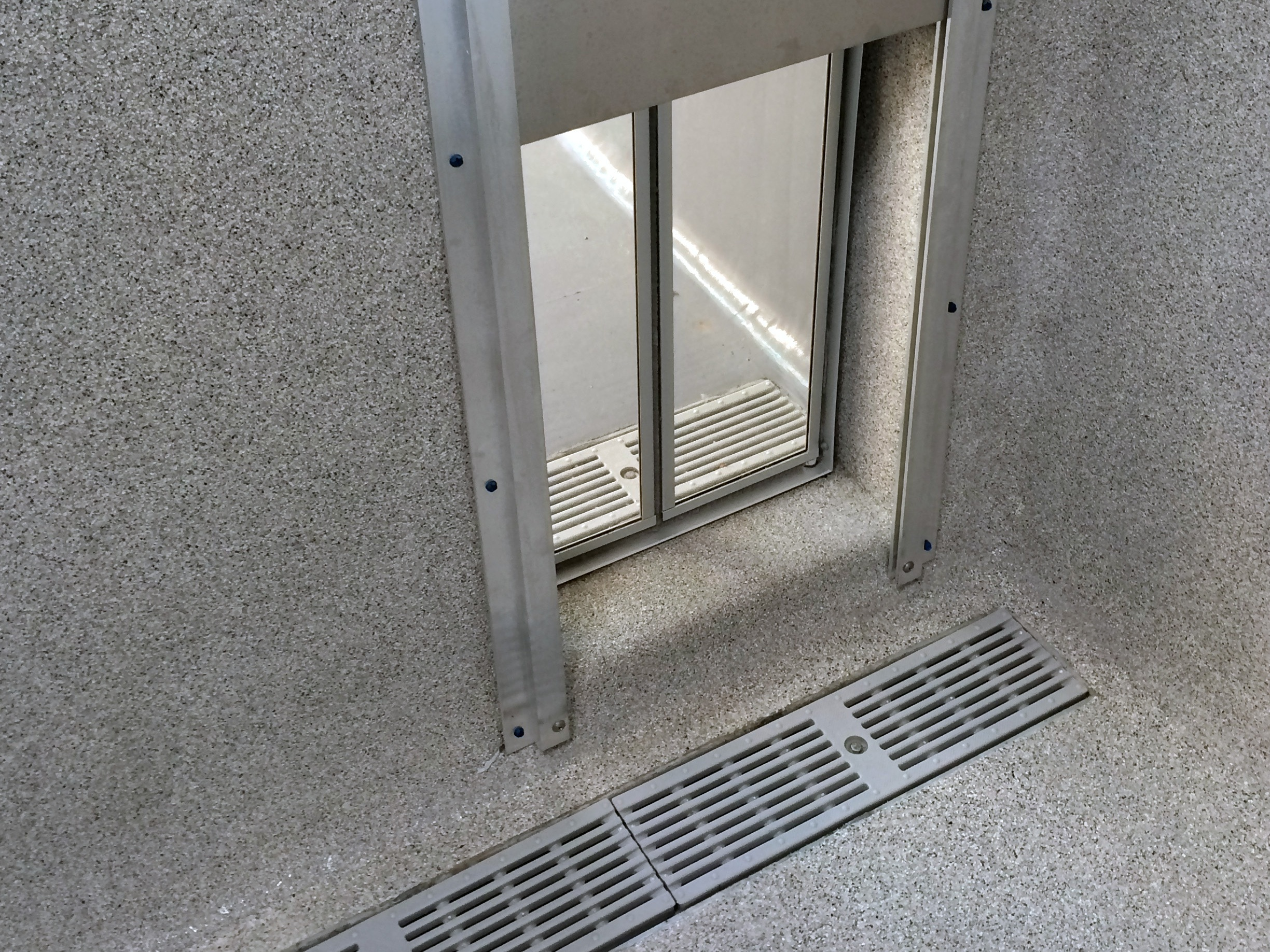 Separate Floor Drains on both side of Indoor/Outdoor Kennels allows for easy Cleaning!