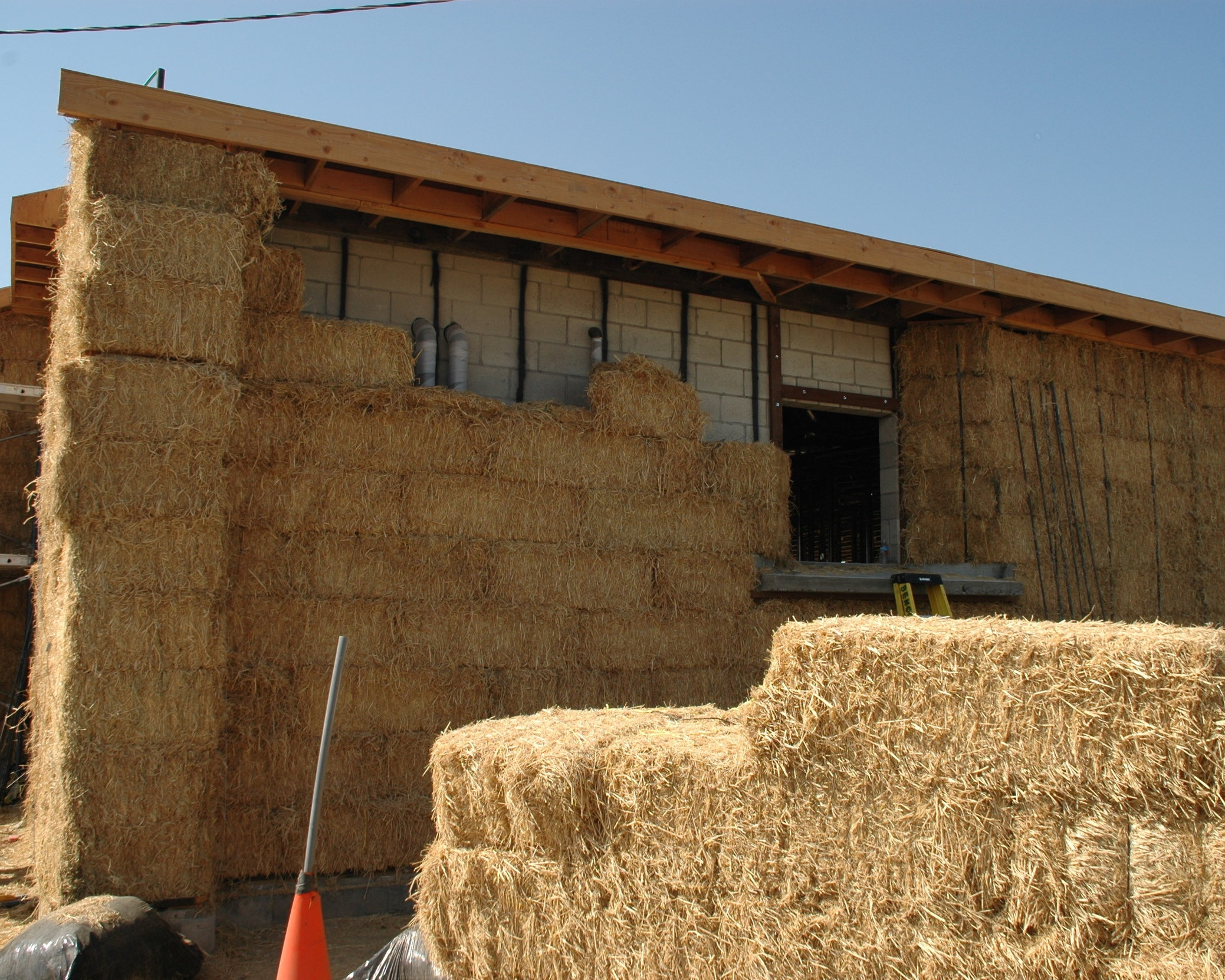 """UTILITY BILLS SLASHED. - Highly energy-efficient straw bale walls provide an equivalent thermal resistance of R-40, more than twice the thermal insulation of standard construction and result in substantially lower heating and air conditioning bills. This, together with proper orientation of windows, a super-insulated and reflective """"cool roof"""", and a night air ventilation system result in utility bills which can be 50% less than conventional construction. The additional building mass provided by straw bale serves as a """"thermal flywheel"""", helping to reduce indoor temperature variation, improving the thermal comfort of occupants."""