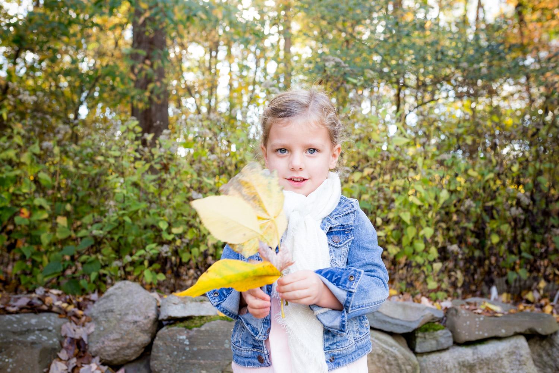 little girl holding her big leaf