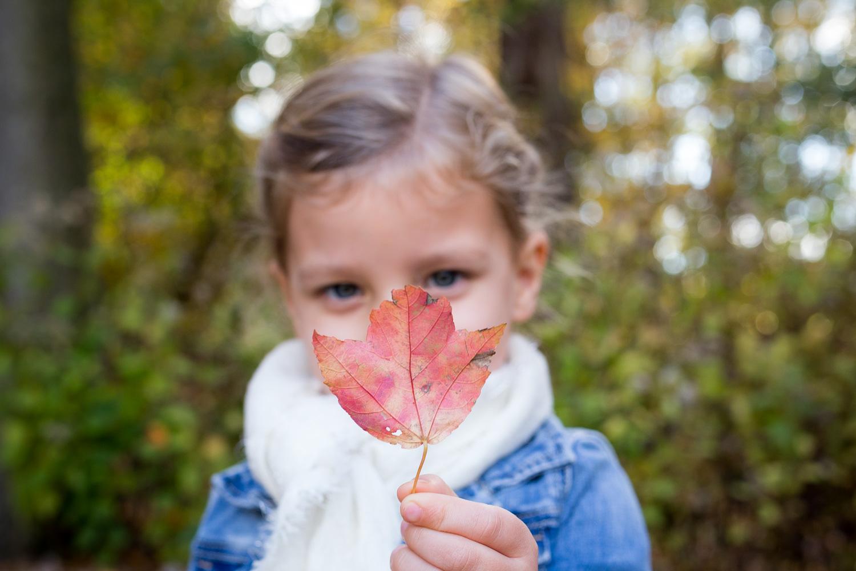 girl with an orange leaf