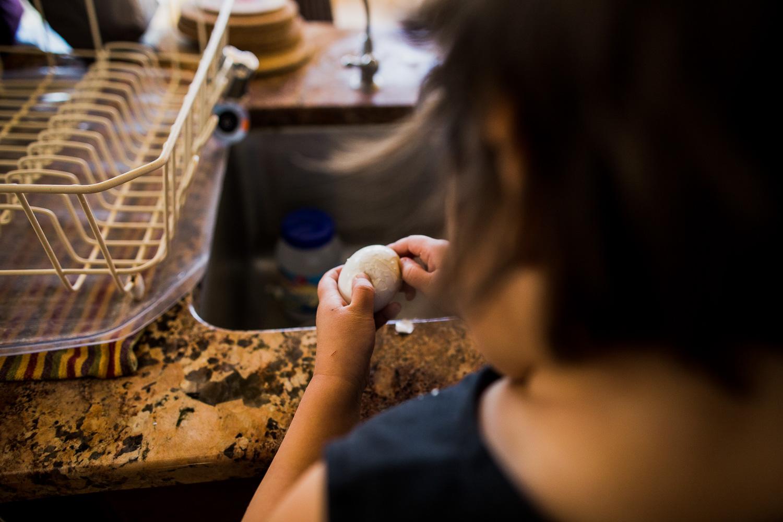 Girl peeling an egg
