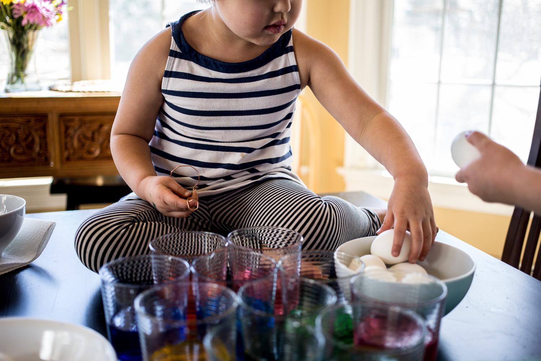 Children coloring Easter eggs