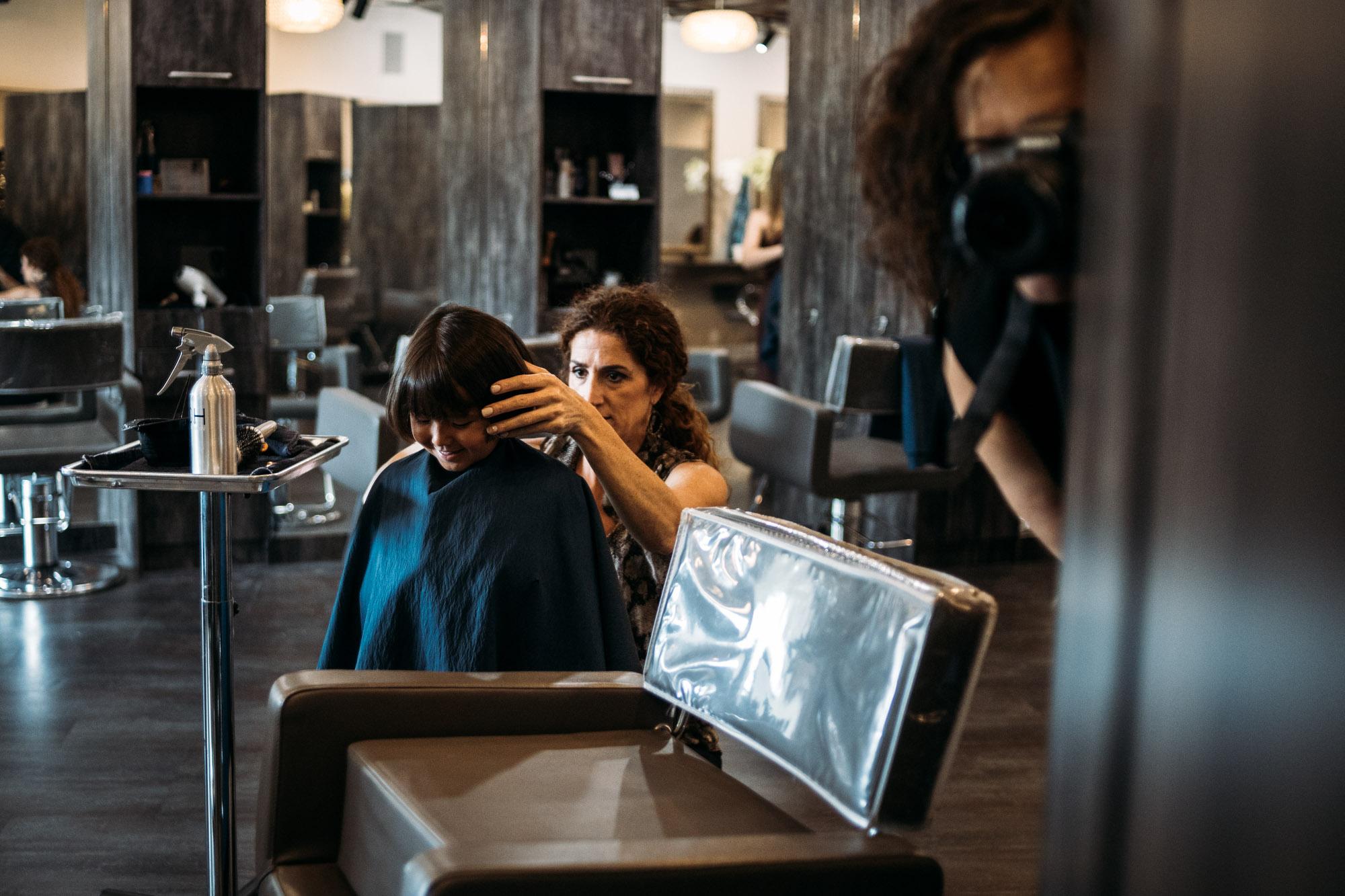 little girl's first haircut