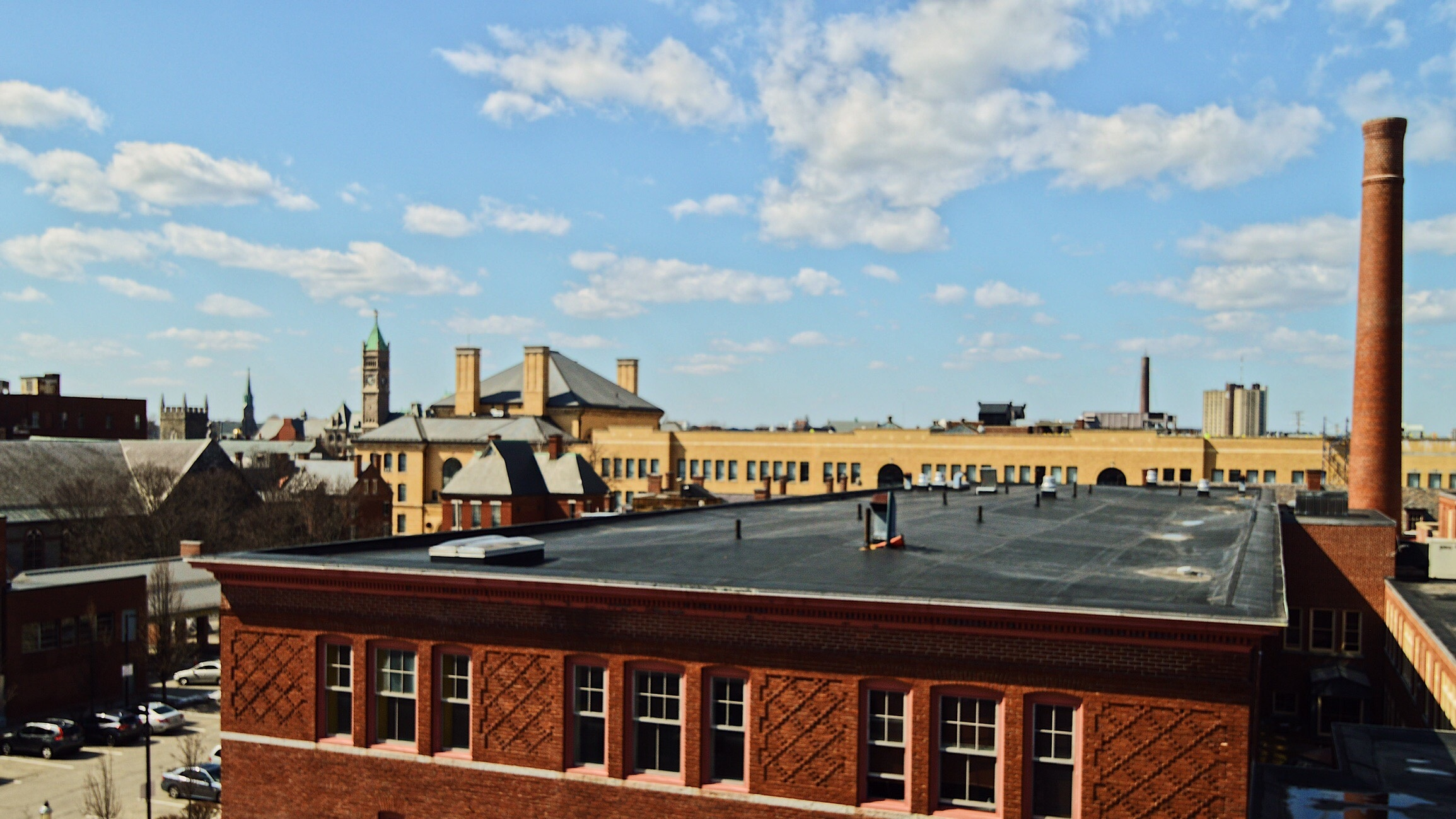 "Southwest view from the Downes Garage of the Lowell Freshman Academy, and architect Harry Prescott Groves's ""raised latticework pattern"" on the former Lowell Trade High School."