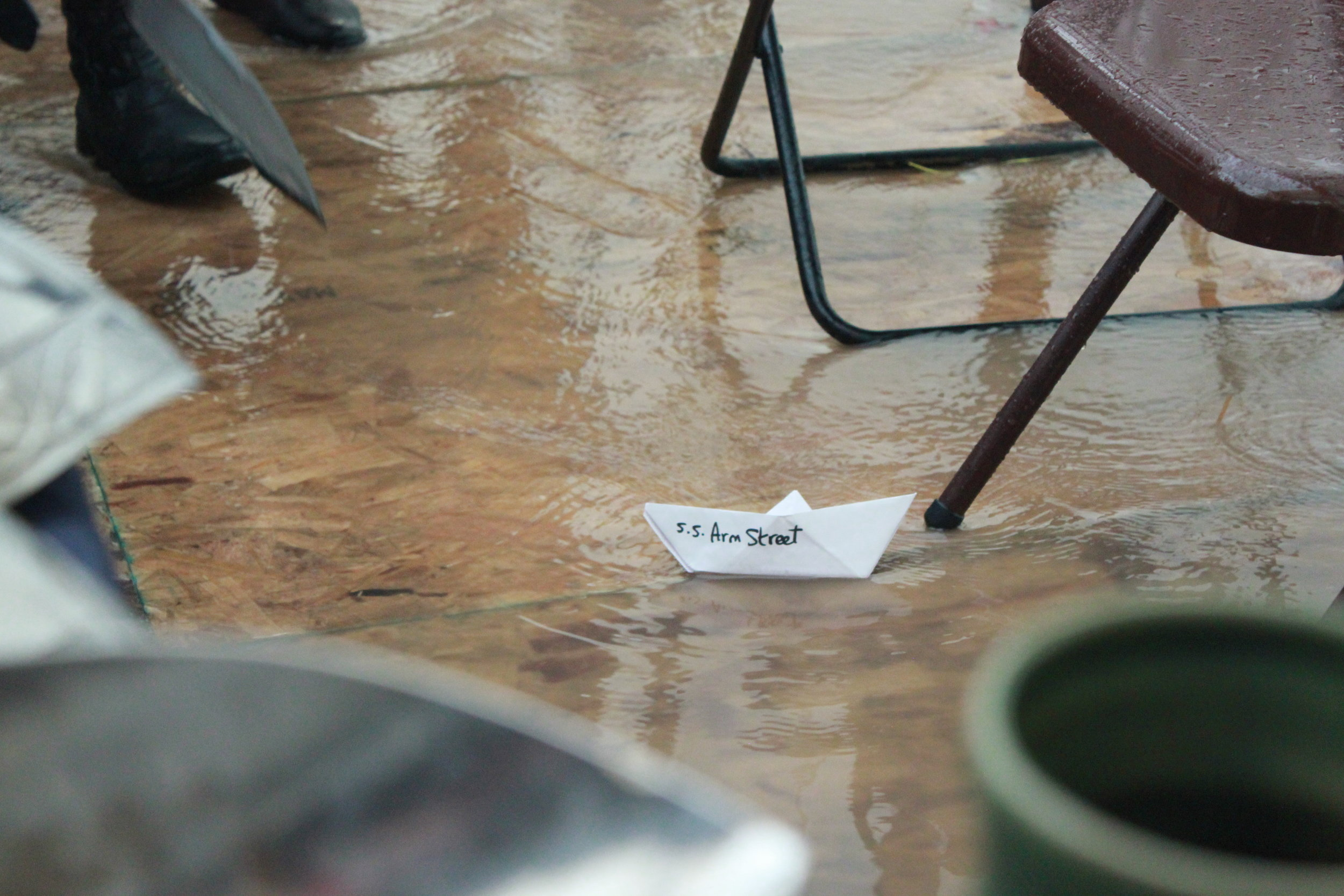 A lone origami boat sailing through our flooded shop.
