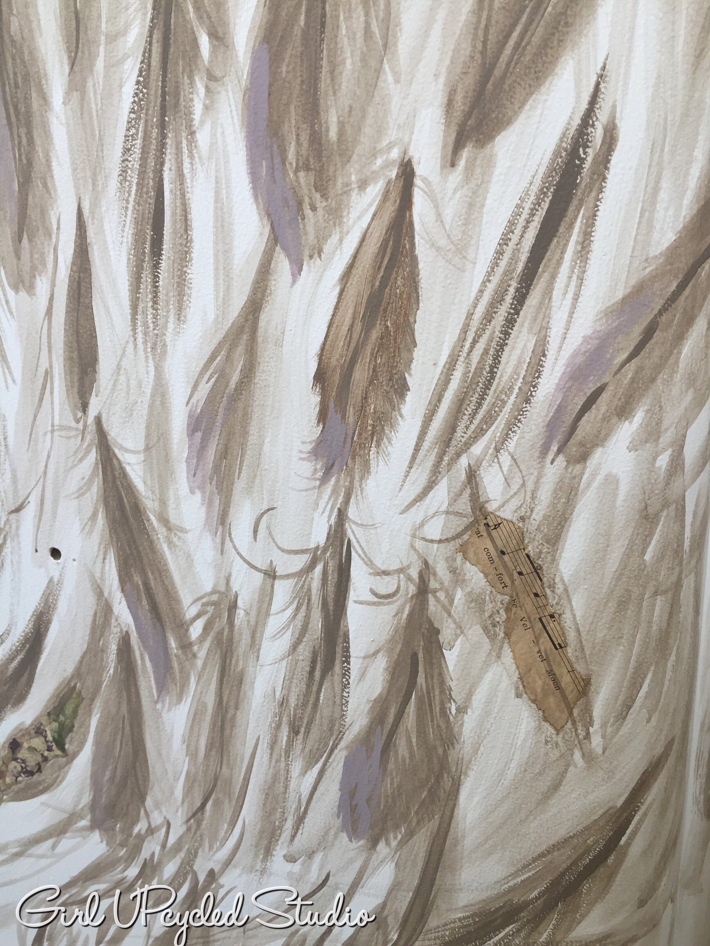 Mixed media with sheet music, wall paper then a touch of lavender paint on the tips of the feather.