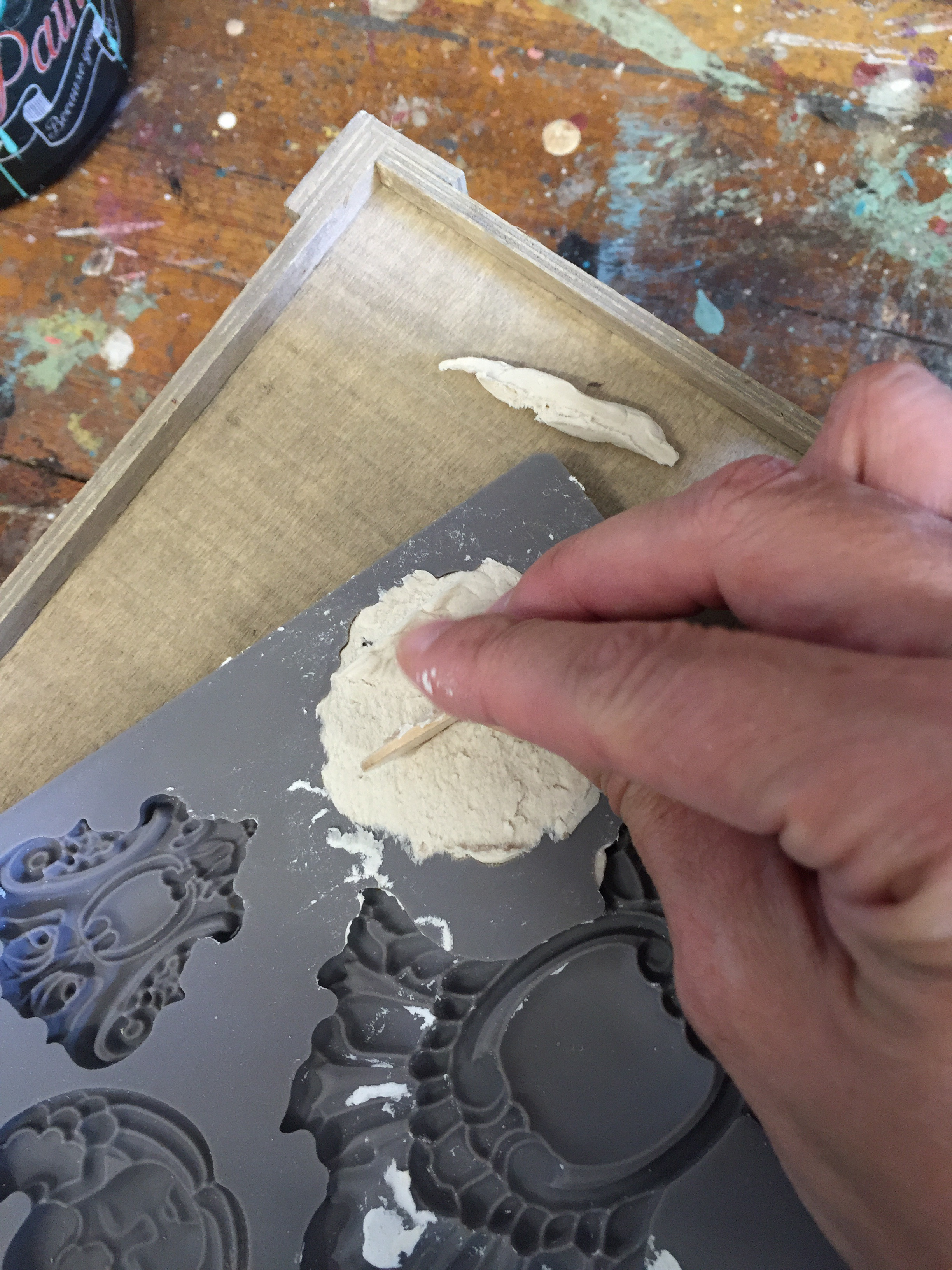 Fill mould with paperclay then use a straight edge to smooth excess off-gently lift off of form-let dry then attach