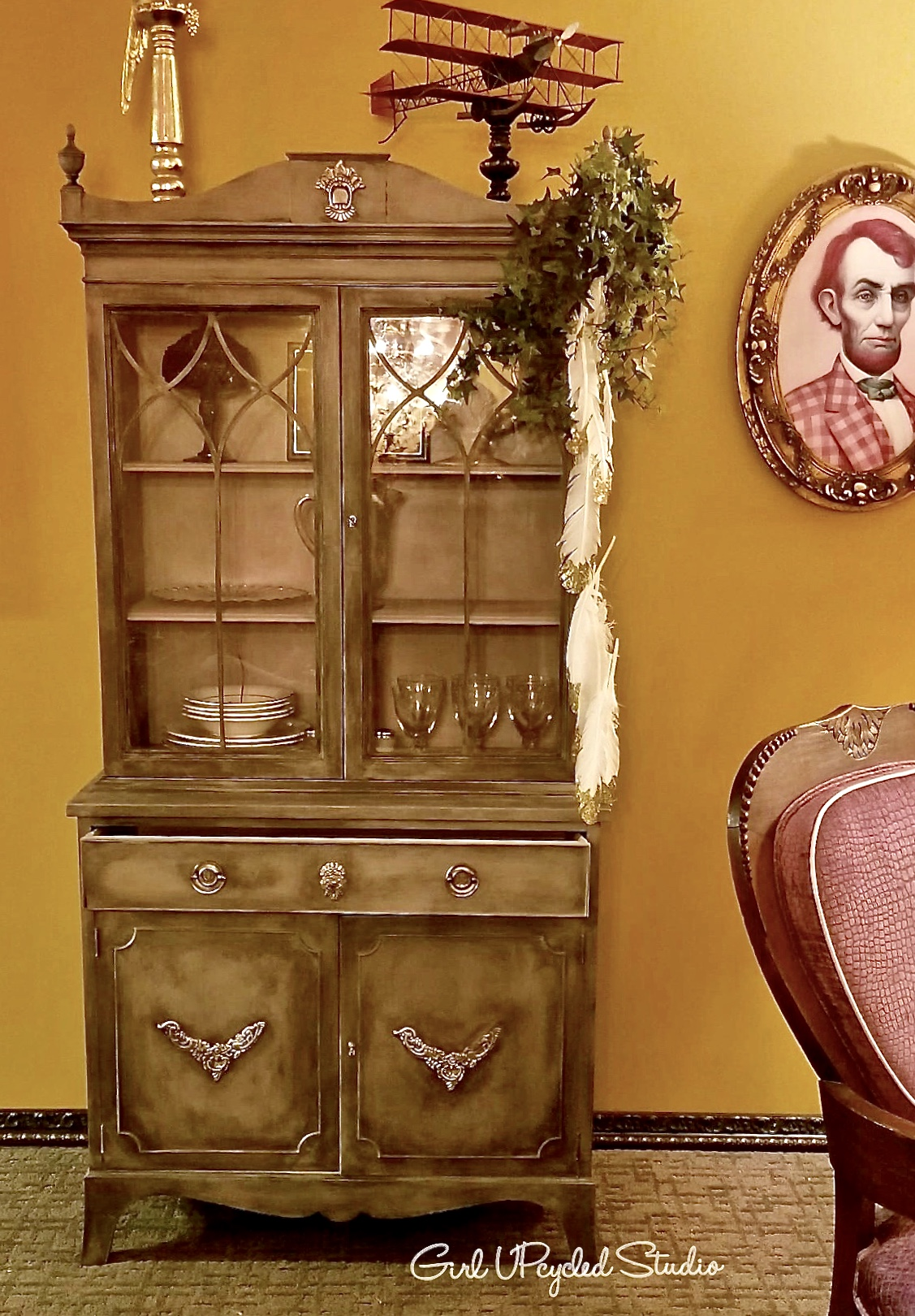 Proudly on display - This is an evening shot of Josephines lovely hutch that is now on showcase at my customers new Art Studio where she spends most of her spare time creating whimsical magical mixed media. The perfect spot for this special custom Painted Furniture project!