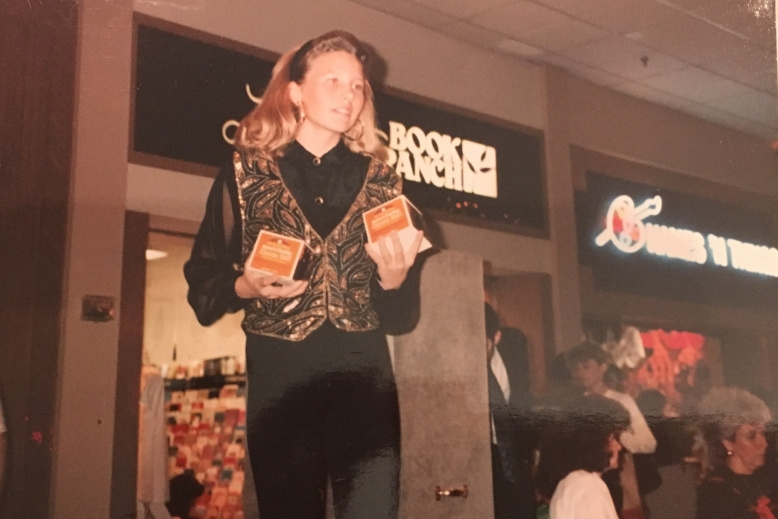 """I was a """"Trendsetter"""" at the Old Hickory Mall. I remember vividly having to """"model"""" cheese balls from Swiss Colony. Why did I think the headband with pushed up bangs was a good look? Check out Names 'N Things in the background."""