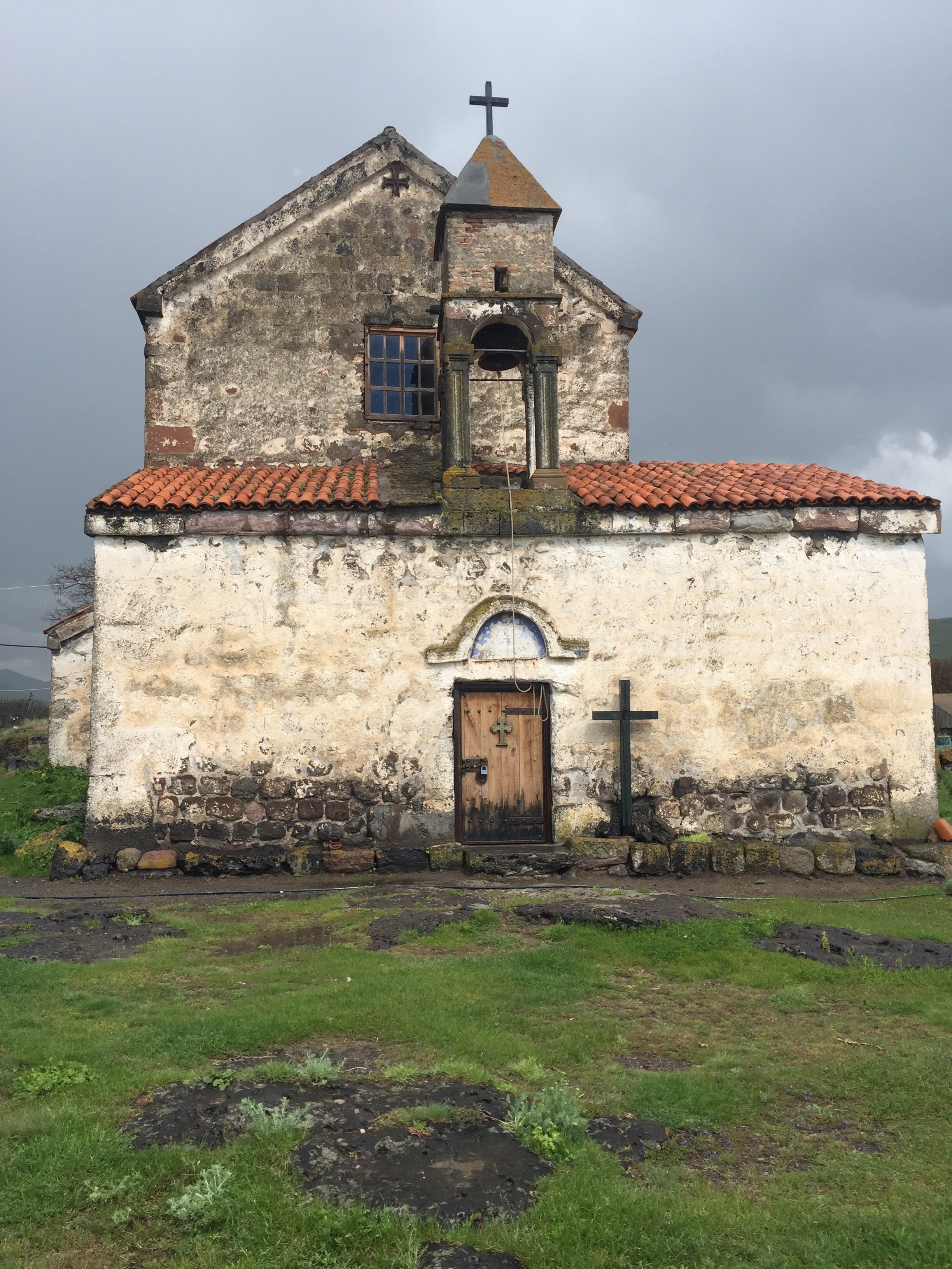 Old church at the top of the hill - storm rising