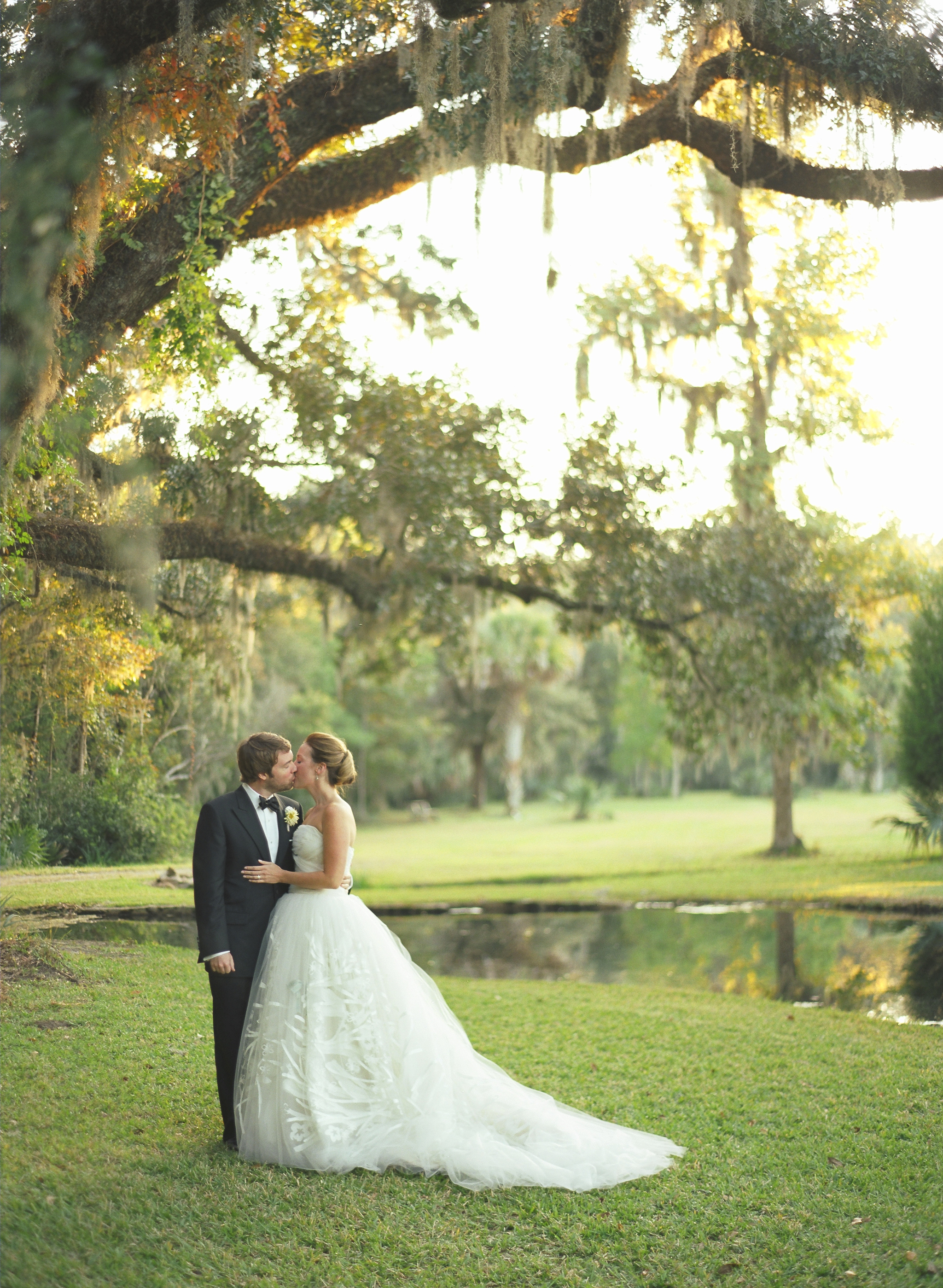 Carter Samis wears a stunning Carolina Hererra strapless ballgown of tulle for her wedding to Fred Fellers in Charleston South Carolina. The wedding was planned by Soirée by Tara Guérard. The reception took place at Historic Drayton Hall.