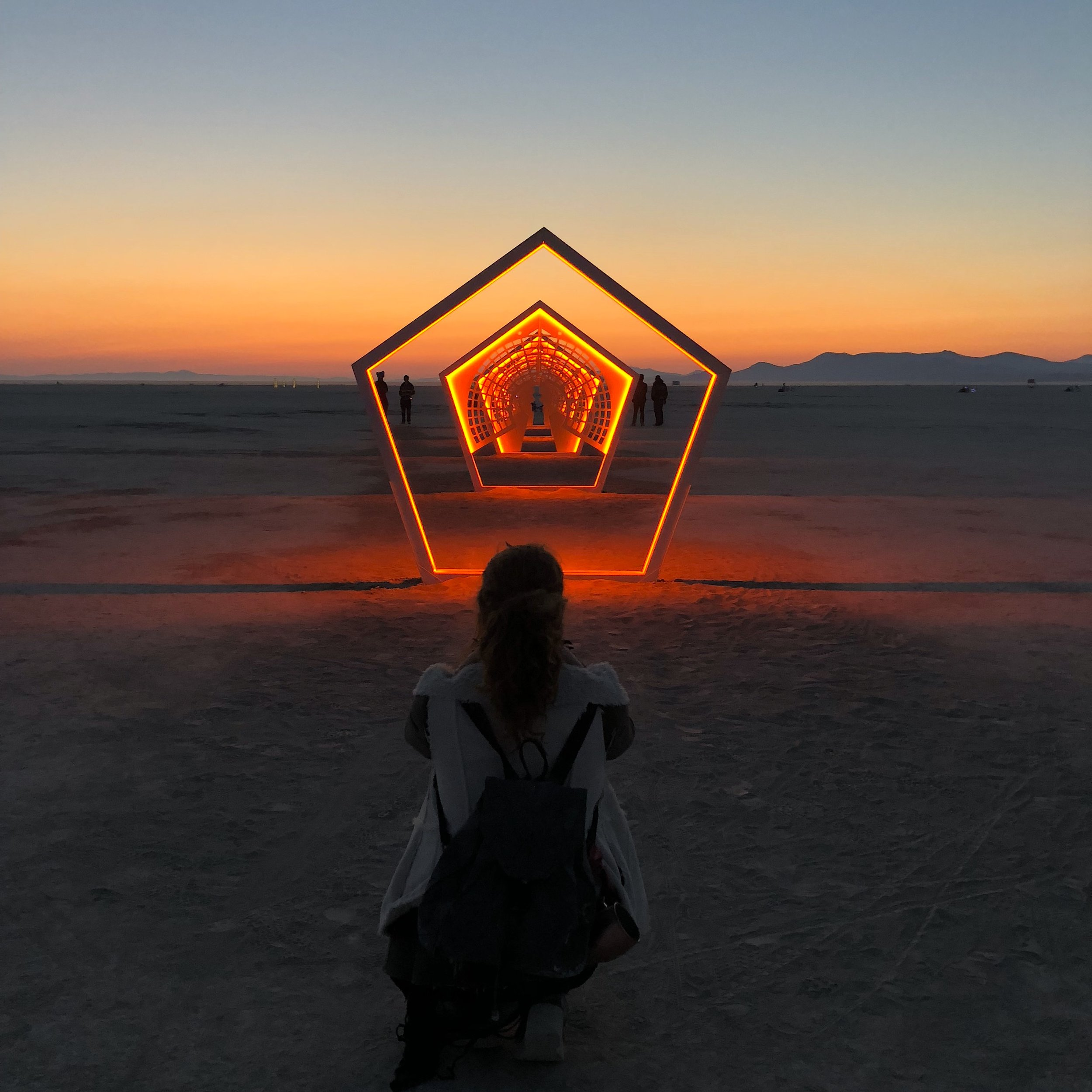 Kate and Passage Home - a sculpture tribute to Larry Harvey- Burning Man 2018-  photo by Shawn Cunningham.jpeg
