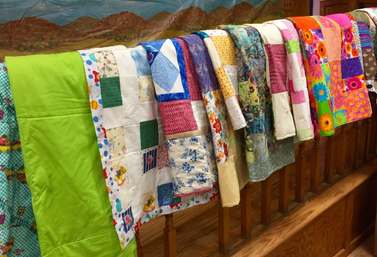 ABC quilts on railing