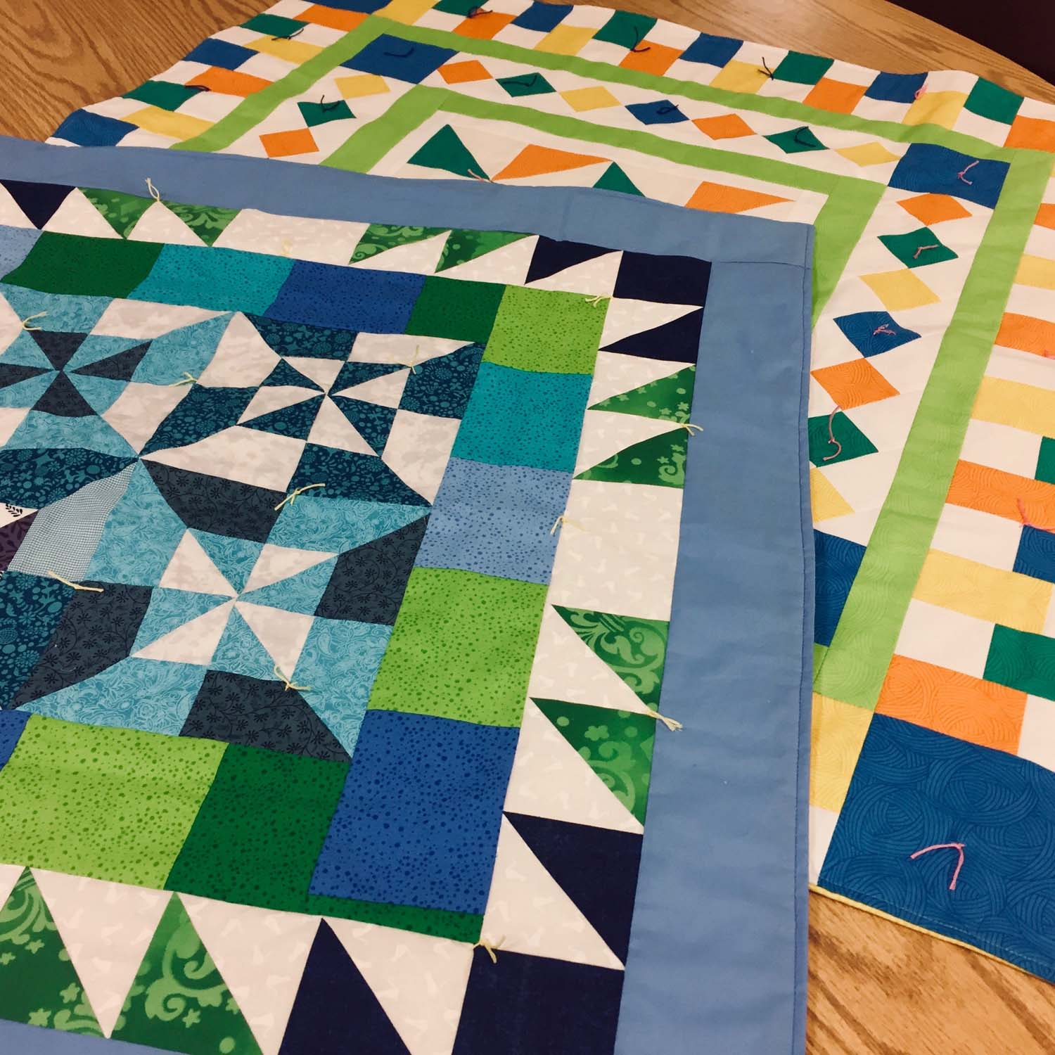"Two of the many ABC charity quilts made at our annual February ""ABC Frenzy"" gathering."