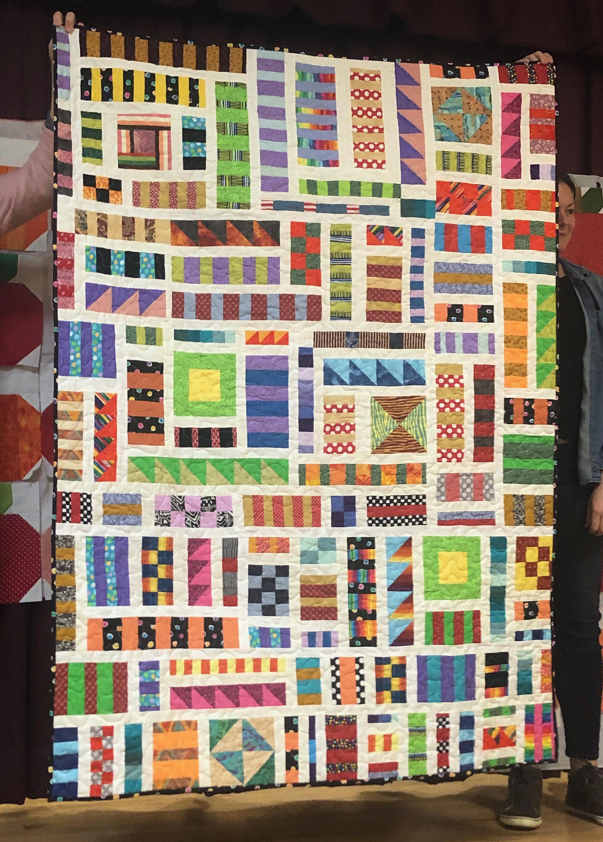 Pat Decker, modern scrappy veteran quilt