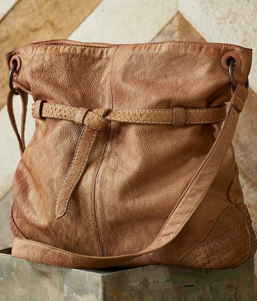 Taryn Tote  A raw, pebbled texture thats wonderfully softened with a cinch at the top to expand or compact.