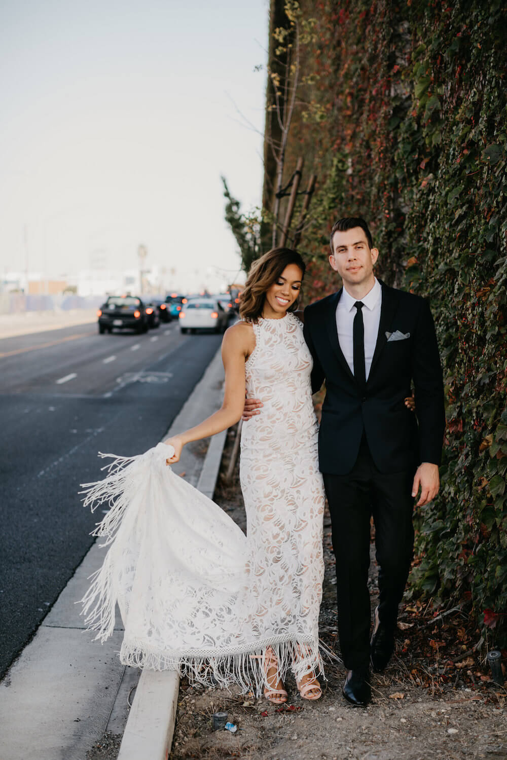 Kalia and Joe, Kalia wears a GRACE LOVES LACE wedding dress