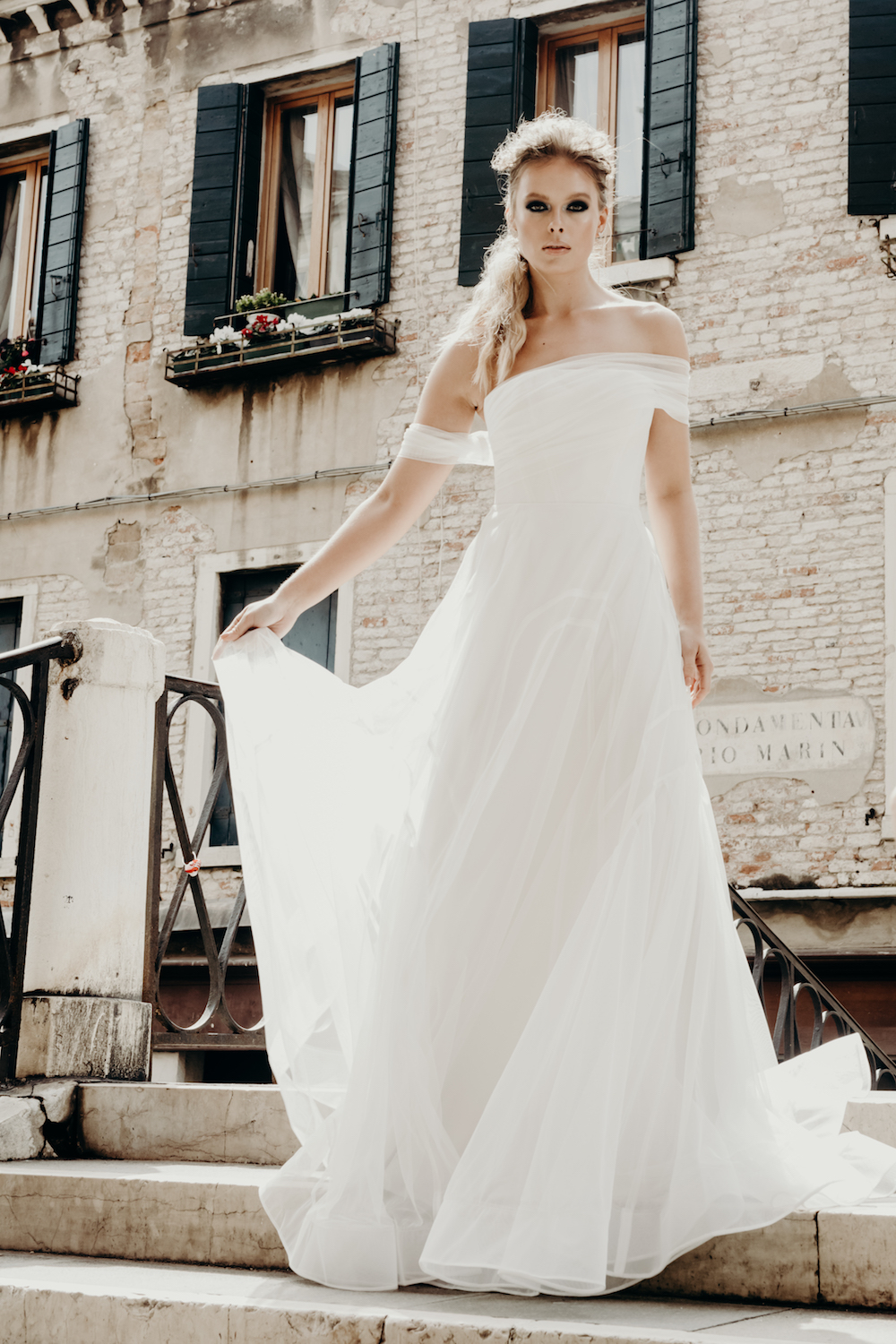 The AMALFI wedding dress from the Georgia Young Couture 'Summer Wine' RTW Collection featured on LOVE FIND CO.