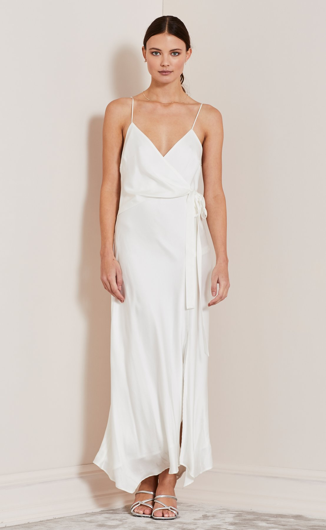 BEC & BRIDGE Heartbeat Wrap dress | 12 Bridal Gowns You Can Buy For Under $1,000 | LOVE FIND CO. Bridal Dress Directory