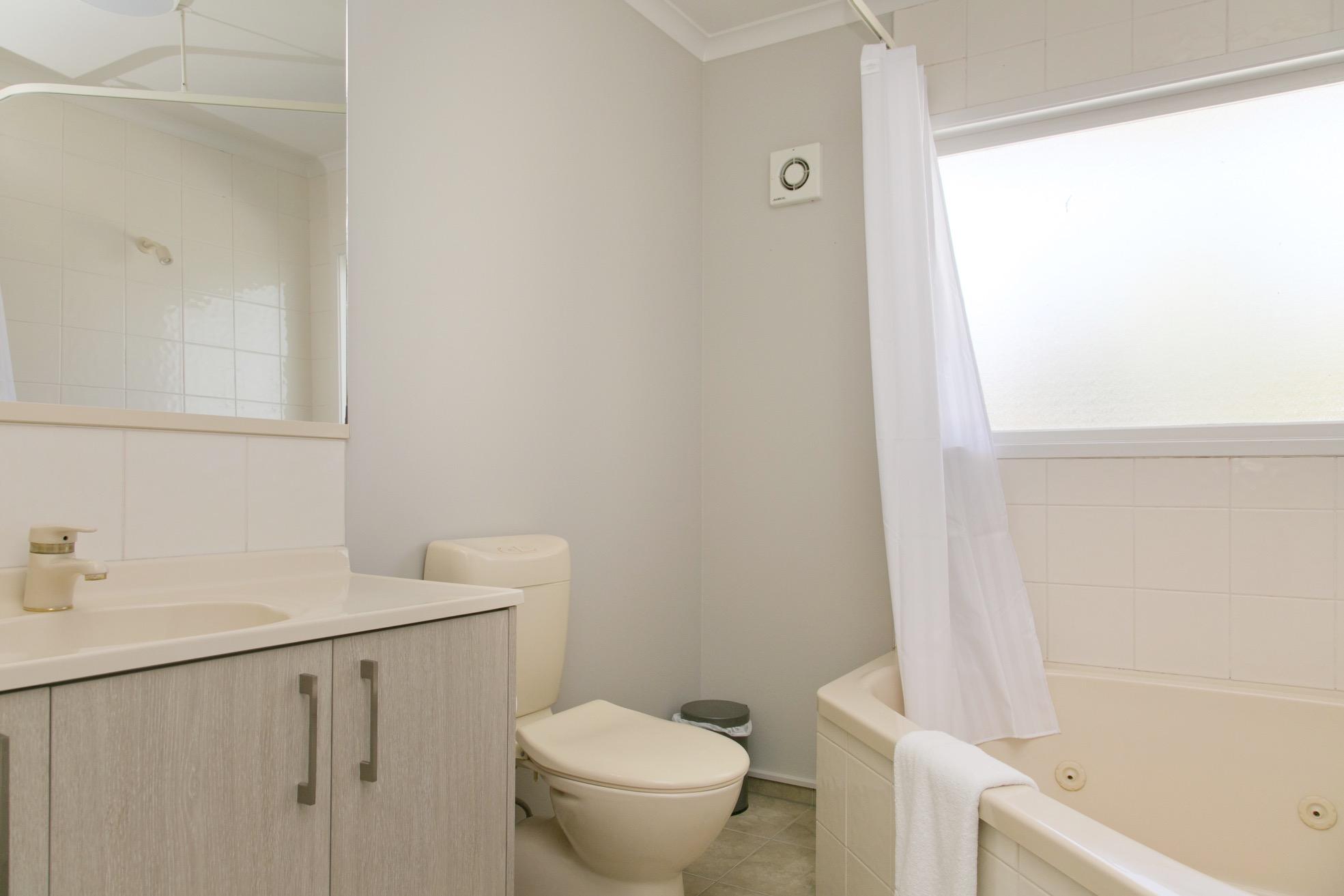 deluxe one bedroom bathroom.jpg