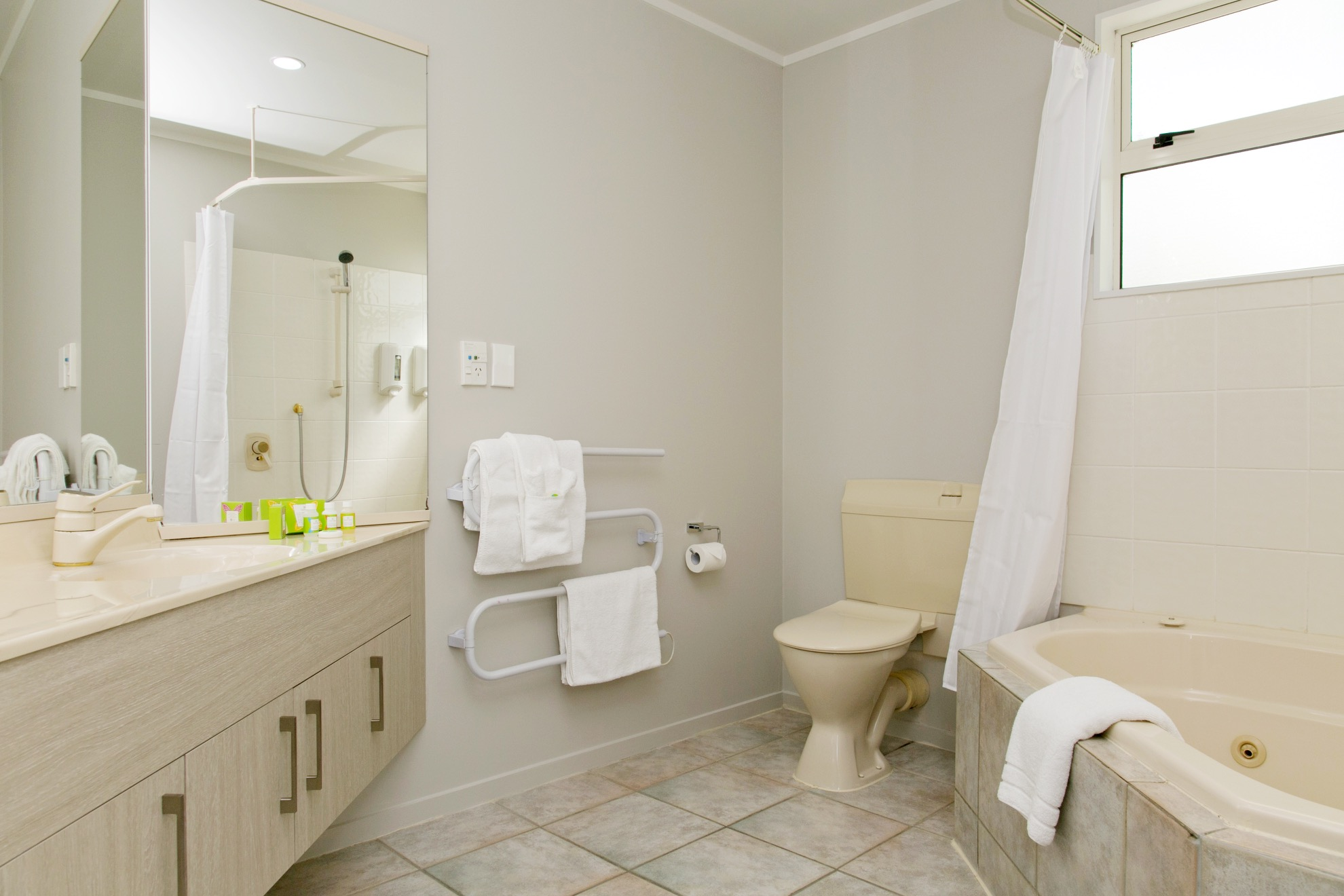 three bedroom bathroom with spa bath.jpg