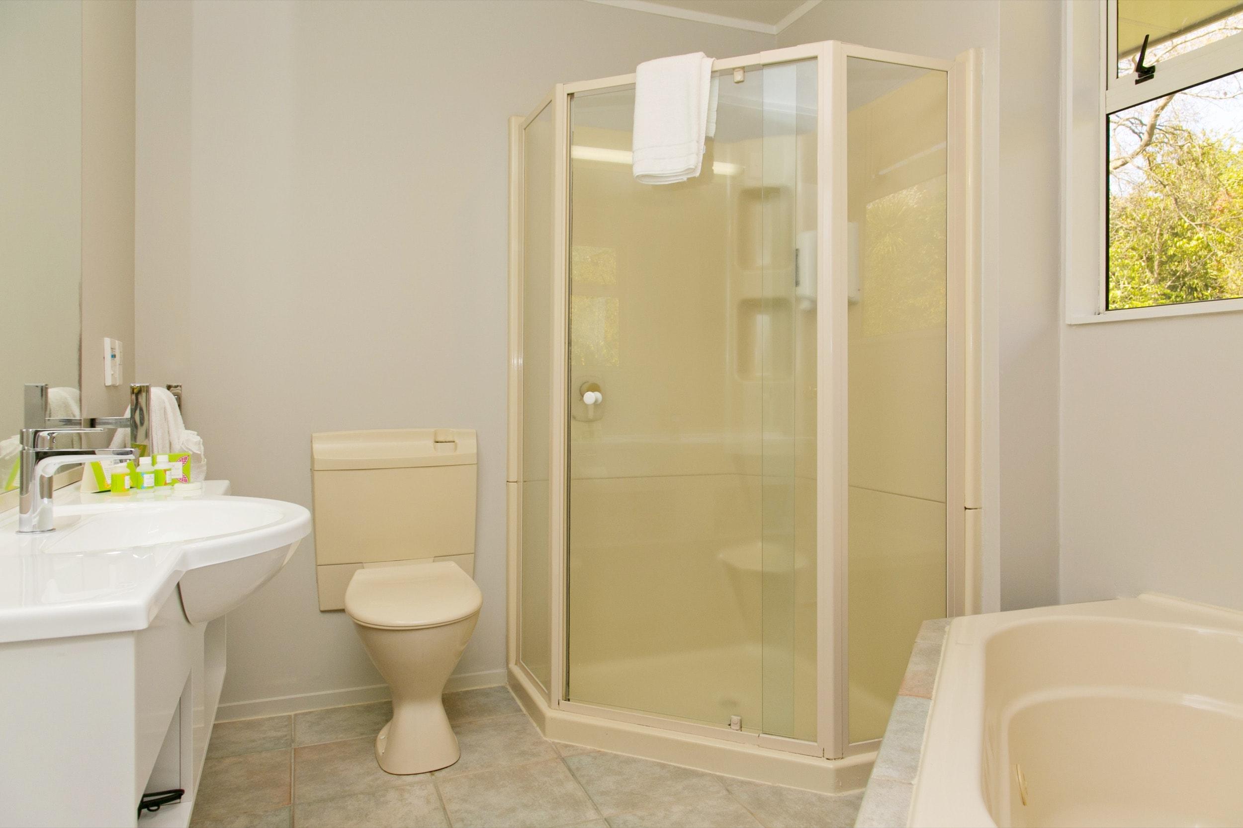 spa studio with lake view bathroom-min.jpg