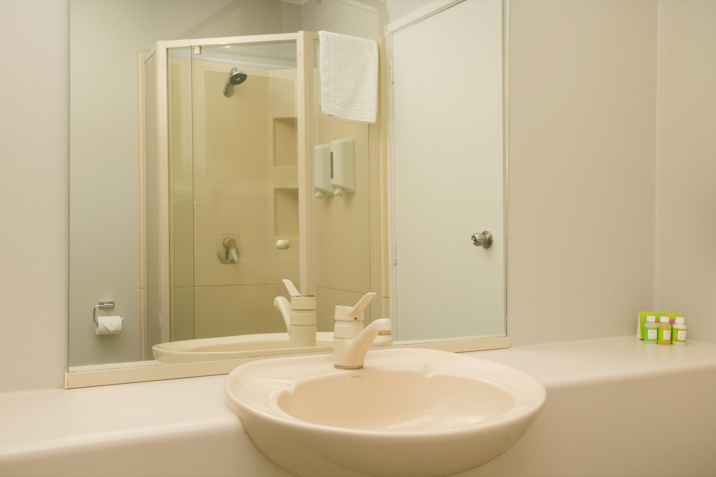 two bedroom poolside bathroom-min.jpg