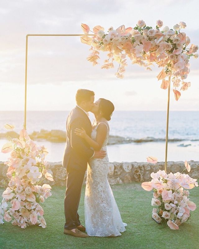 Magic Hour | The guests flew in from as far as London, New Zealand and Japan to see these two love birds get hitched in Hawaii and we are pretty sure none of them will ever forget this perfect day! We designed the ceremony arch of our dreams and @mandygracedesigns brought it to life even more beautifully than we imagined with help from a custom built gold arch by @alohaartisans. As featured in @martha_weddings with perfect captures by the talented @omalleyphotographers