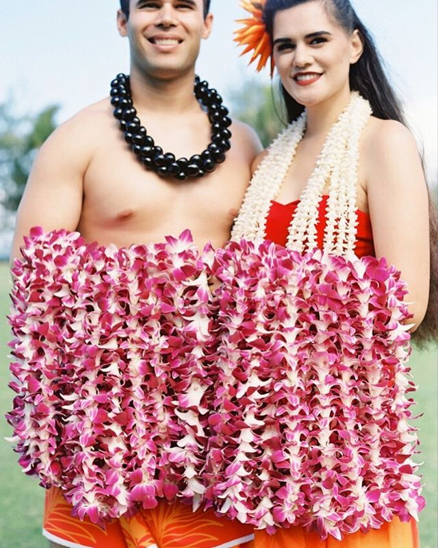 Destination Wedding | It is always a great idea to have a welcome event for your guests when they are traveling to your destination wedding. We love to have fun with our welcome events and in Hawaii that often means welcoming our guests with a traditional lei greeting with local lei greeters, like we did at this wedding weekend earlier this year.  It is also a great time to highlight destination specific customs, foods or flowers into your design, so your guests can experience more of the destination. | Lei Greeters @ringoffirehawaii | Photo @omalleyphotographers |