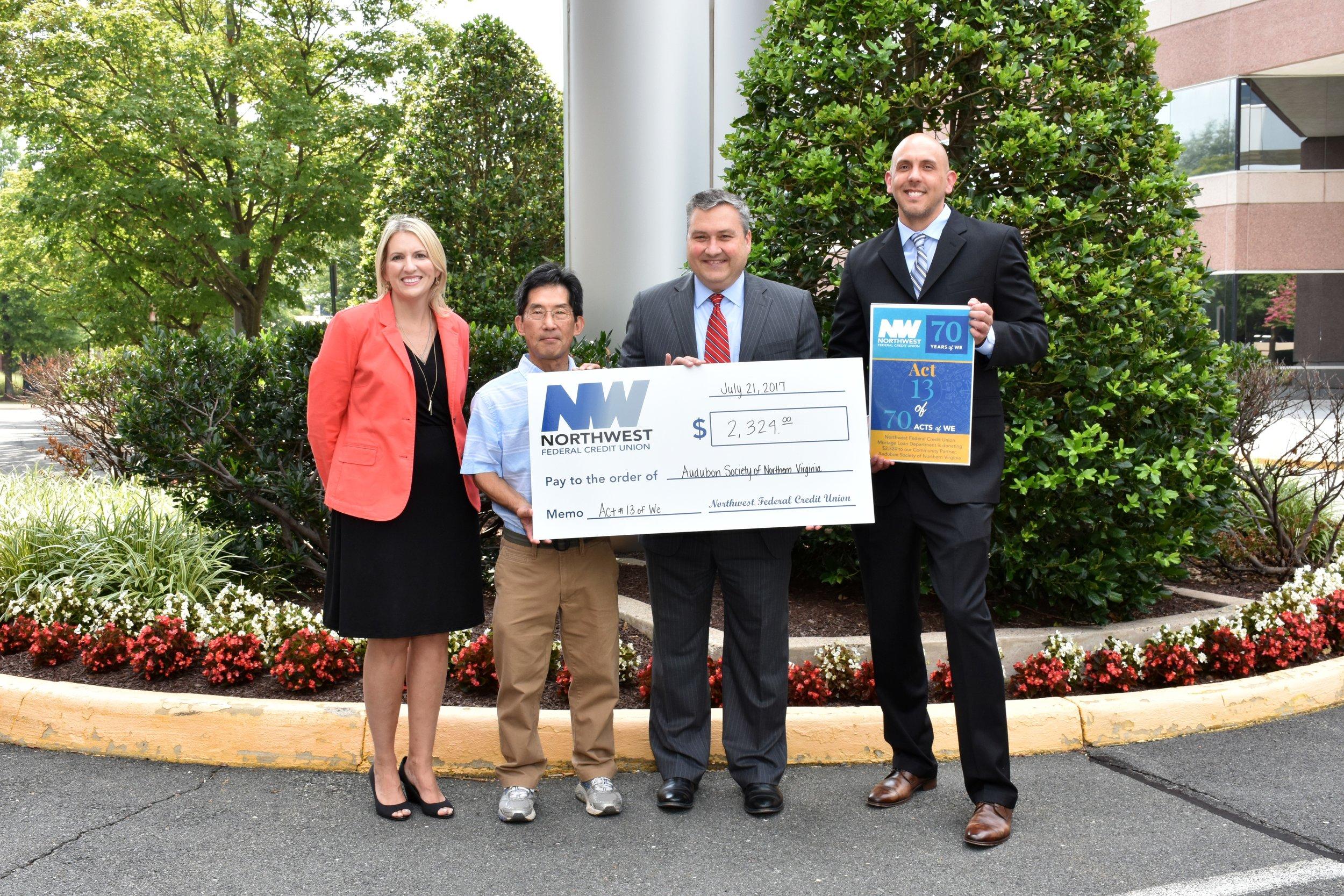 Carl Kikuchi Receiving Donation from Northwest Federal Credit Union