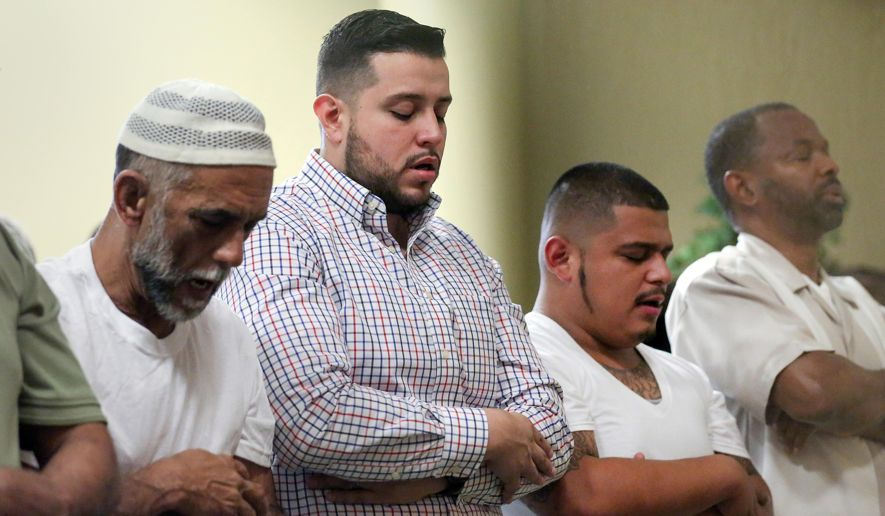 "Alex Gutierrez, second from left, prays during Friday prayers in the mosque at the Islam in Spanish Centro Islamico, Friday, Aug. 5, 2016, in Houston. Gutierrez, the director of development and operations, was raised Catholic, but he has been a Muslim for 12 years. In its first months, Centro Islamico welcomed 28 new converts to Islam, said Gutierrez, Islam in Spanish's development and operations director. ""They were all Latinos — families, single mothers, couples with children. We've had 10-year-old sisters; we've witnessed a grandmother accepting Islam."" (Jon Shapley/Houston Chronicle via AP)"