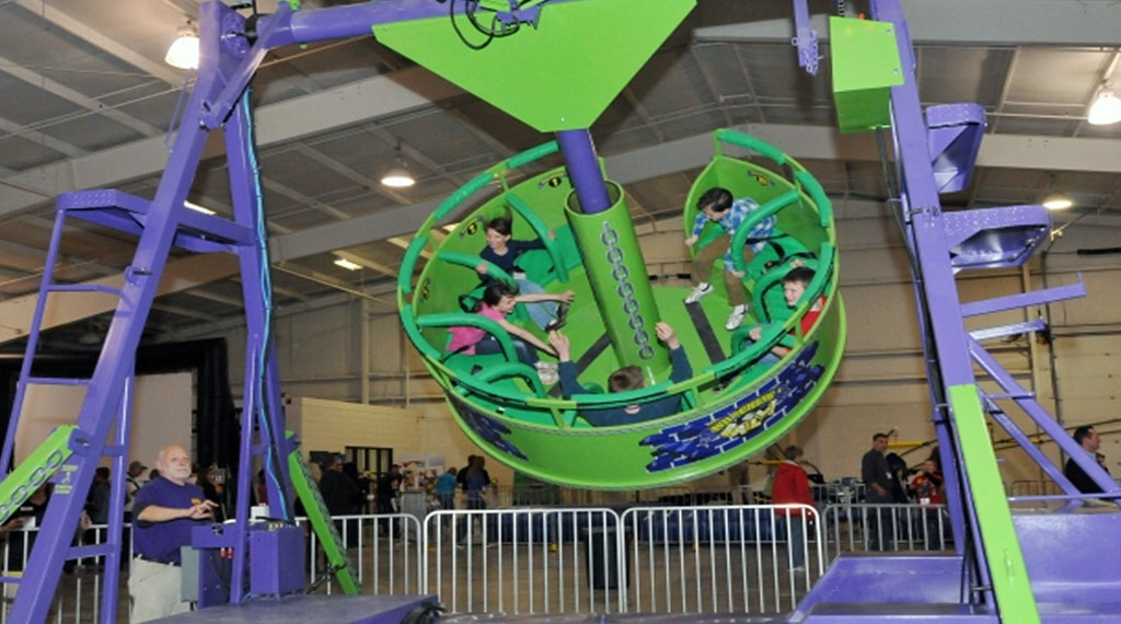 The Wrecking ball - The wrecking ball carnival ride consists of an open seated platform suspended from a giant pendulum. Riders swing back and forth while spinning giving them an exciting ride.