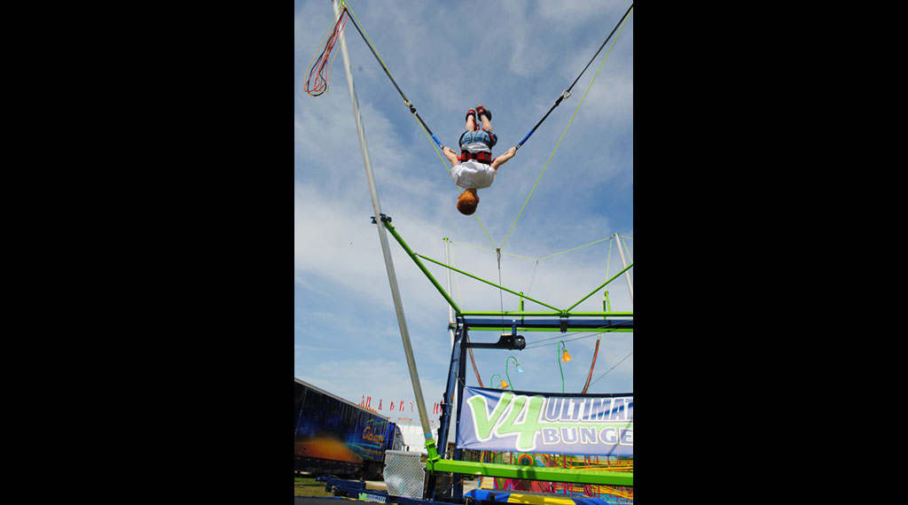 Ultimate Bungee - The V4 Ultimate Bungee is a high flying bungee trampoline experience!It is one of the most sought after rides in any carnival. This ride has height and weight restrictions.