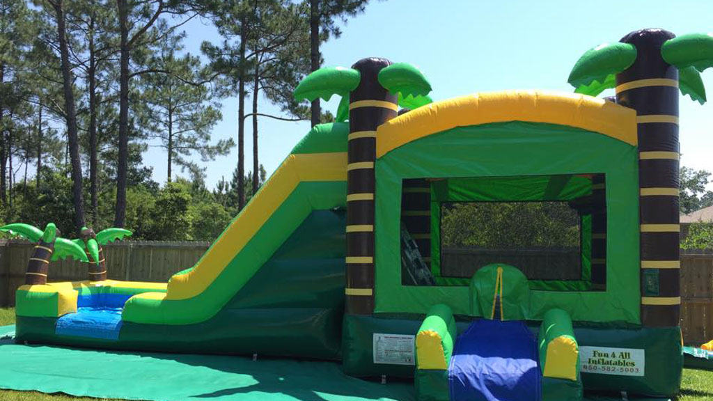 Bounce House - Enjoy super bouncy sliding fun with the Tropical Combo. Enter the safe closing bouncy house and jump. Then climb the rock wall up to the giant slide. It's fun for kids, and just as much fun for adults!
