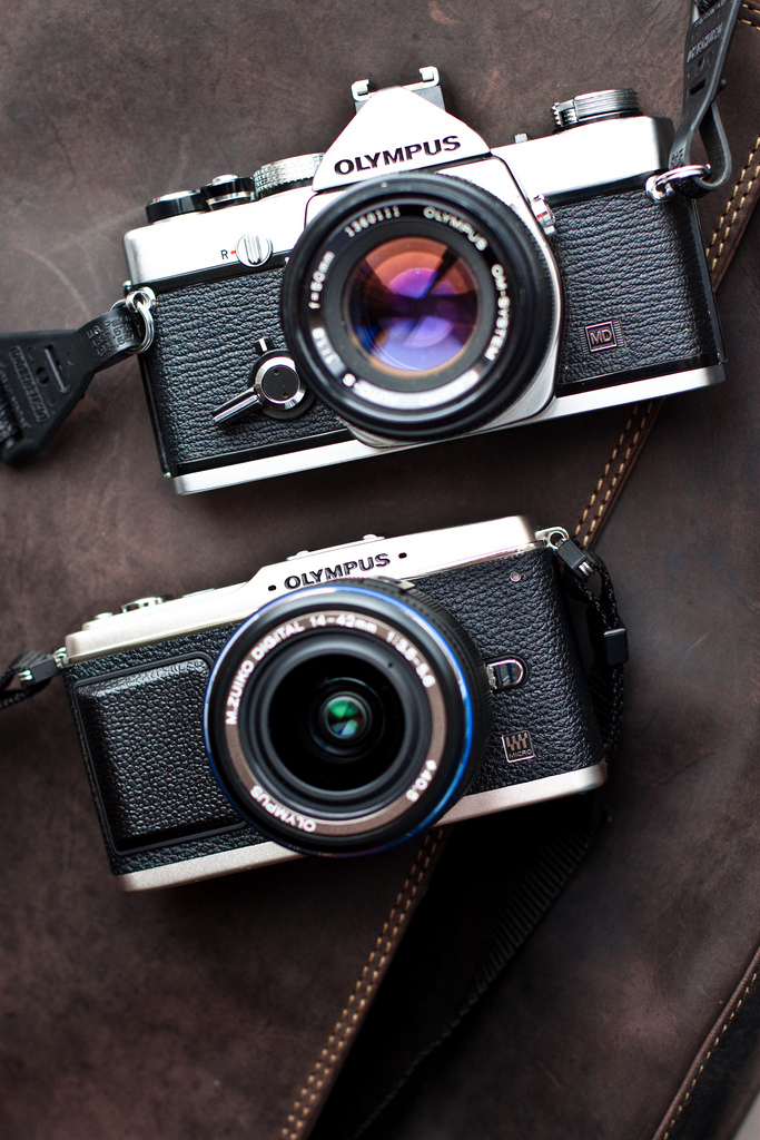 The Olympus EP-1 ( bottom ) looking rather handsome next to its much older and wiser film OM-1 ( top )