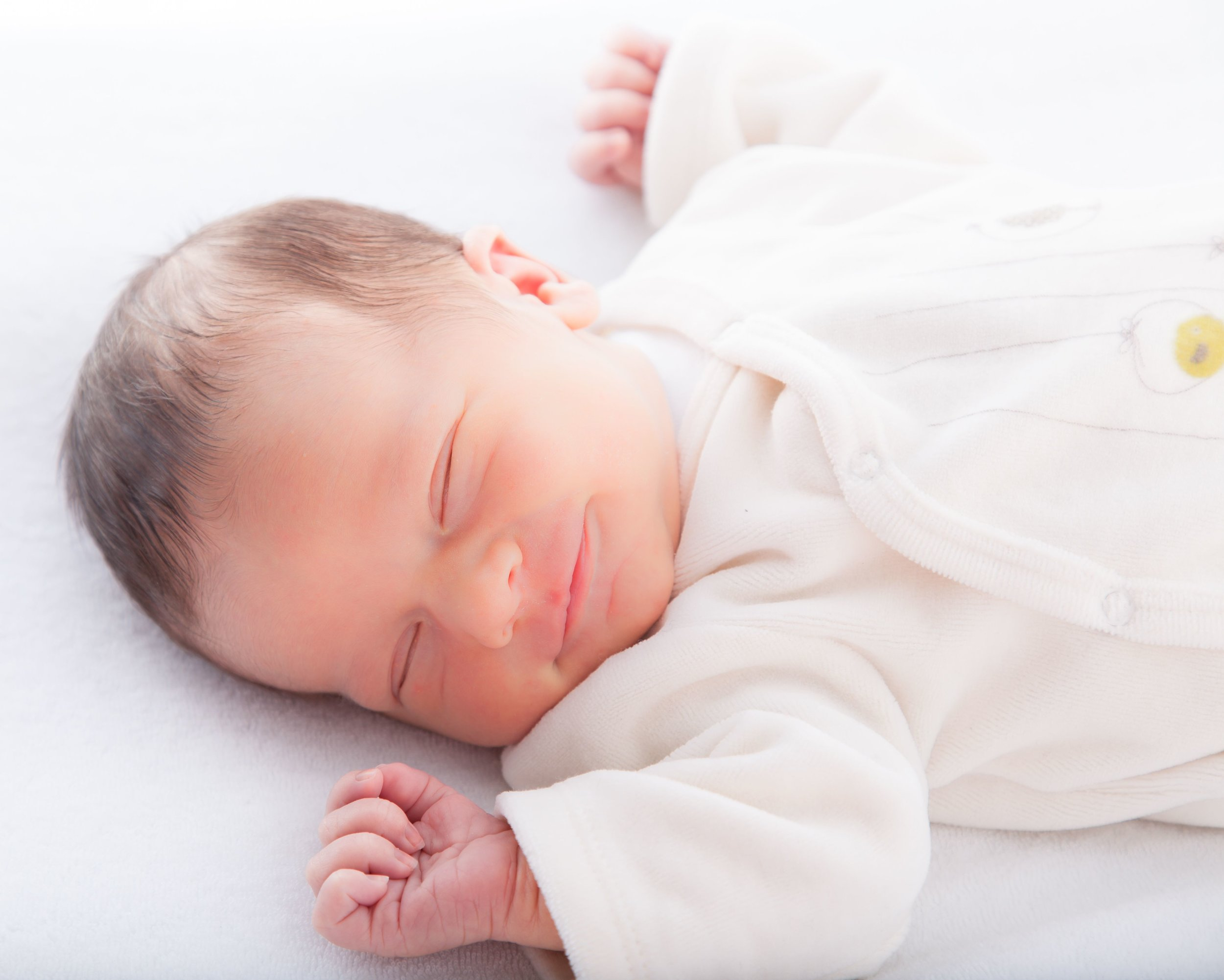 Infant asleep smiling Capitol Hill Infant Sleep