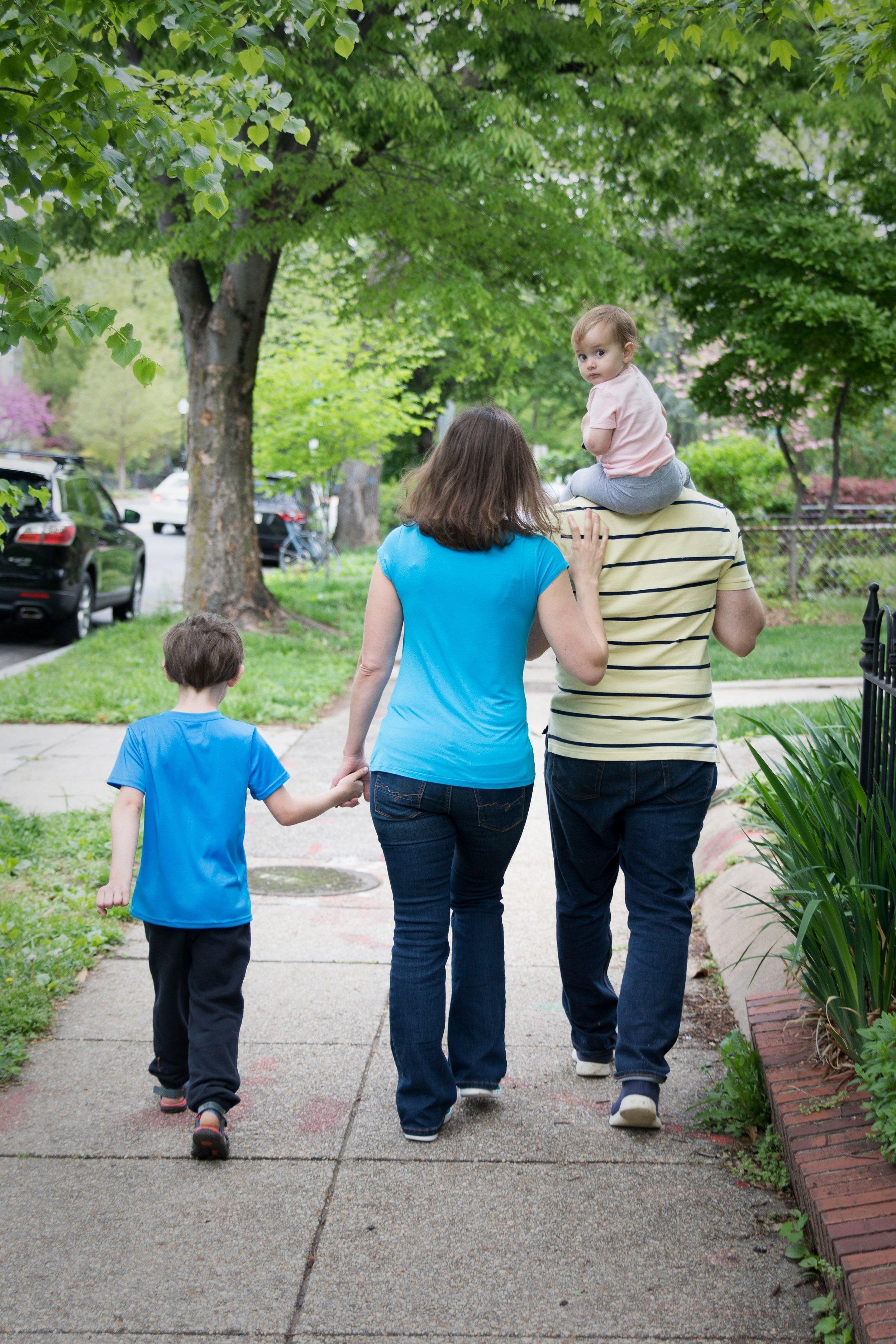 Kim Hawley and family walk down a Capitol Hill Washington DC sidewalk