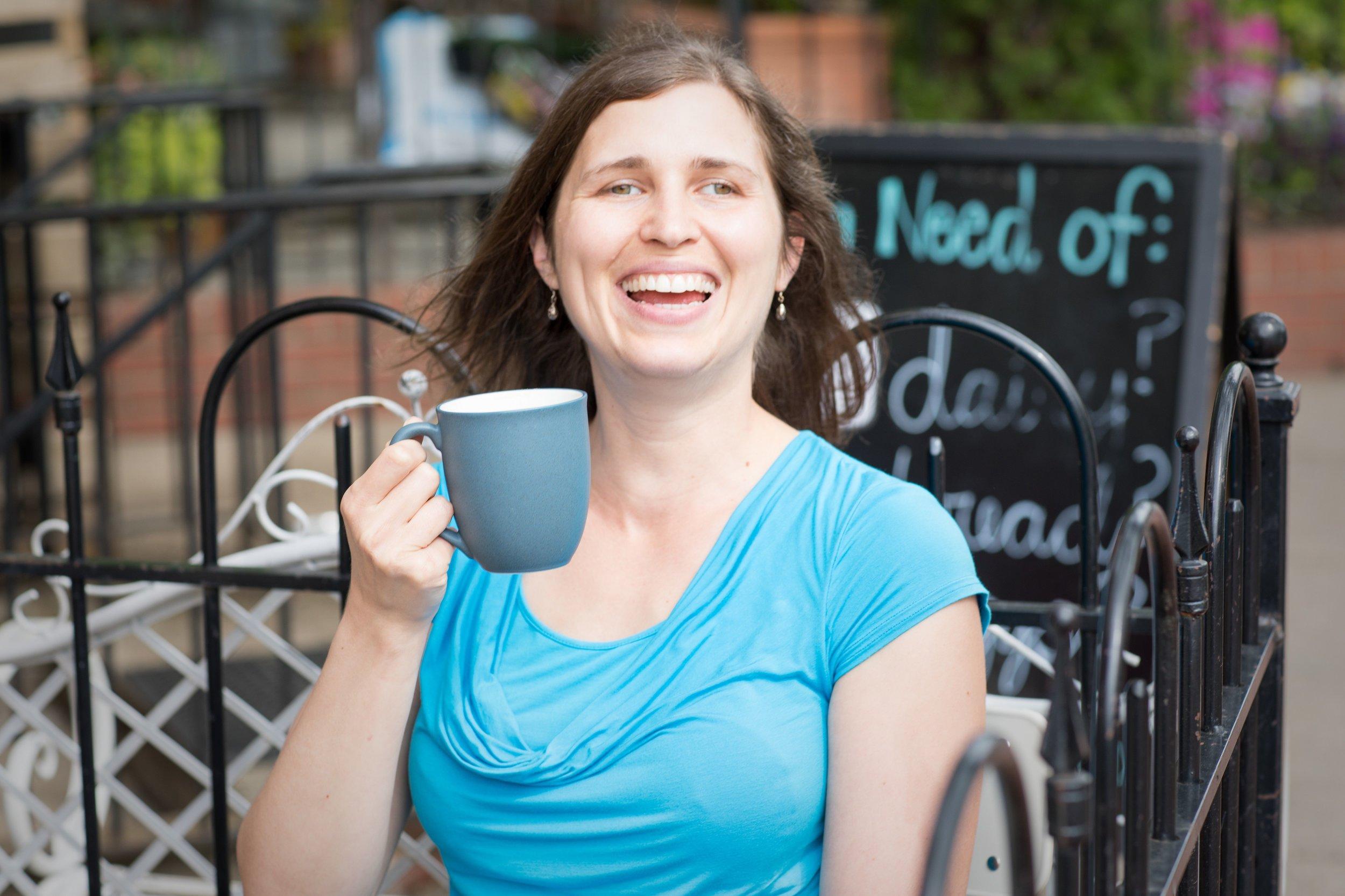 Kim Hawley Holistic Sleep Consultant drinks coffee in Washington DC