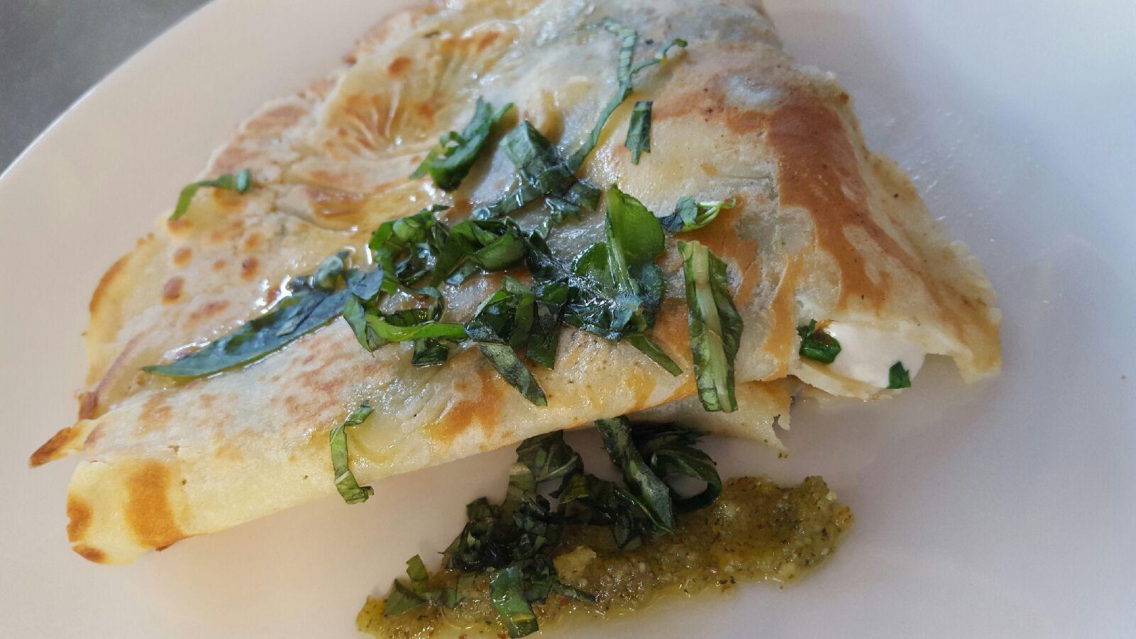 Caprese savory crepe - melted fresh mozzarella, fresh basil, tomatoes and house made pesto.jpg