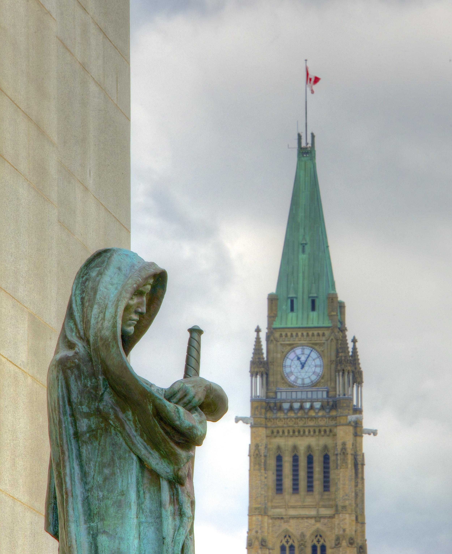 """Statue Ivstitia (Justice)"" by Jamie McCaffrey is licenced under CC 2.0."