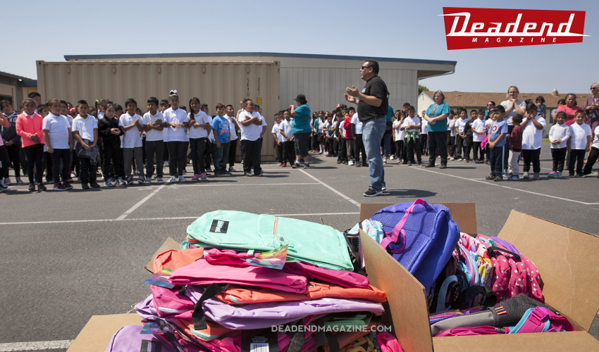 Principal Mr. Marquez letting the students know about the backpack drive.