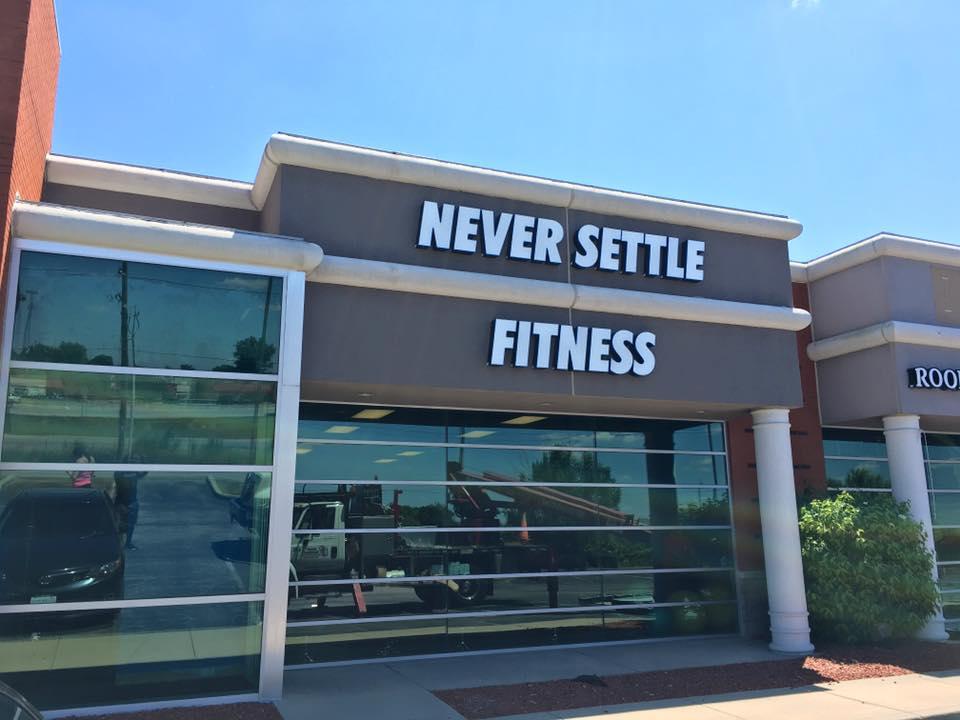 never-settle-fitness-sign.jpg
